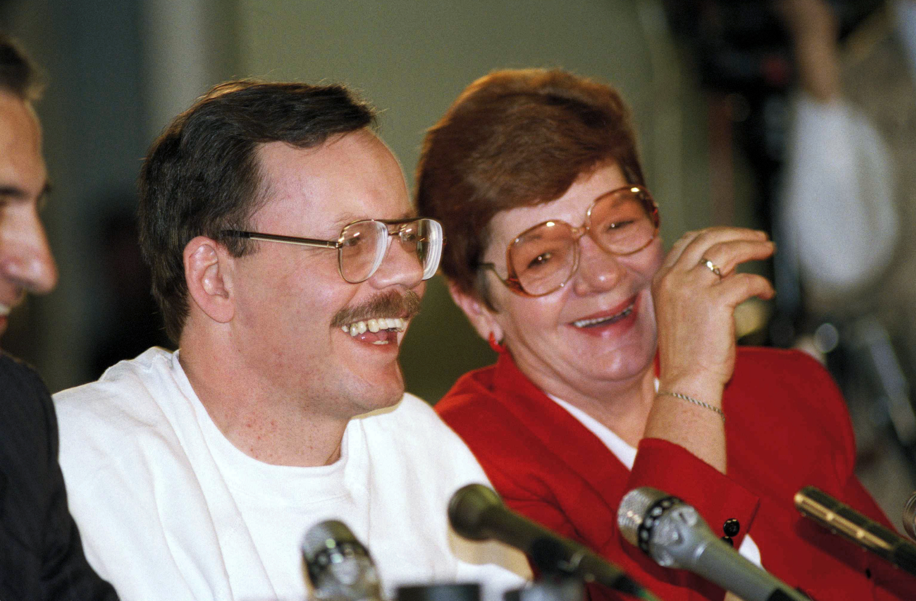 FILE - Former U.S. hostage Terry Anderson and his sister Peggy Say enjoy a light moment during Anderson's news conference in Wiesbaden, Germany, Dec. 6, 1991.
