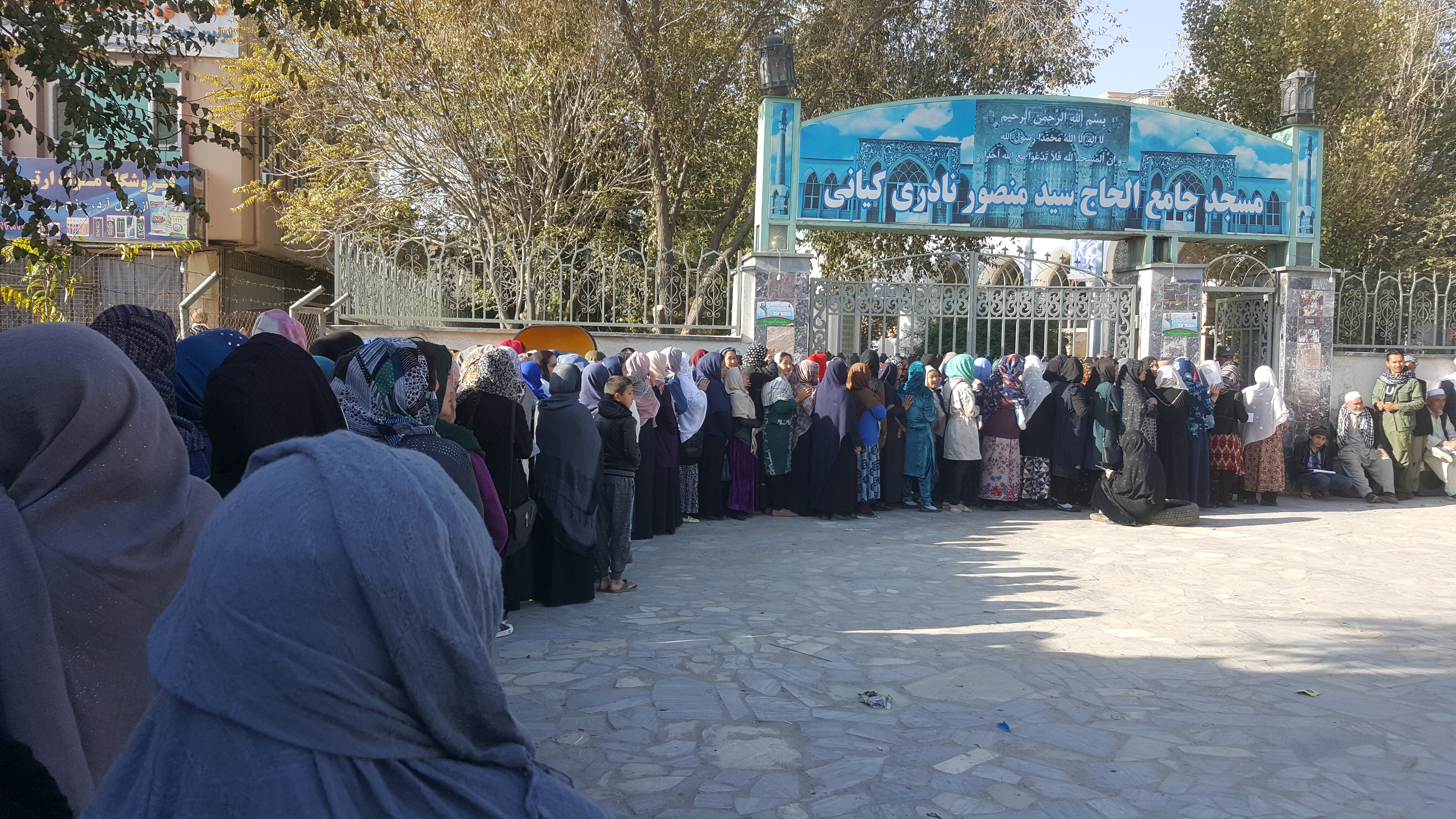 A long line of women wait to cast their ballots outside a Kabul polling station, Oct. 20, 2018.