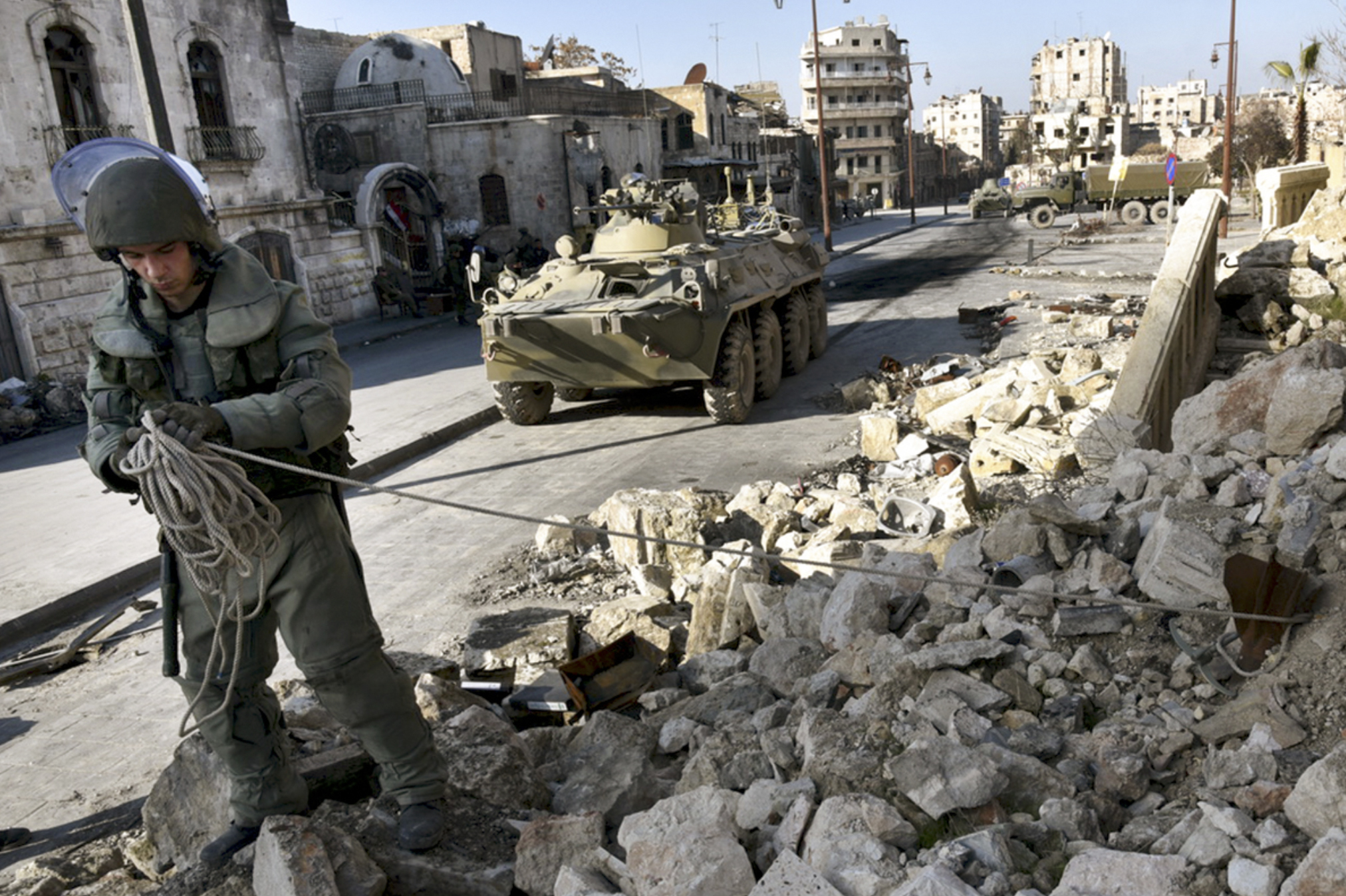 This photo made from the footage taken from Russian Defense Ministry official website on Feb. 4, 2017, claims to show a Russian sapper looking for mines in a street in Aleppo, Syria.