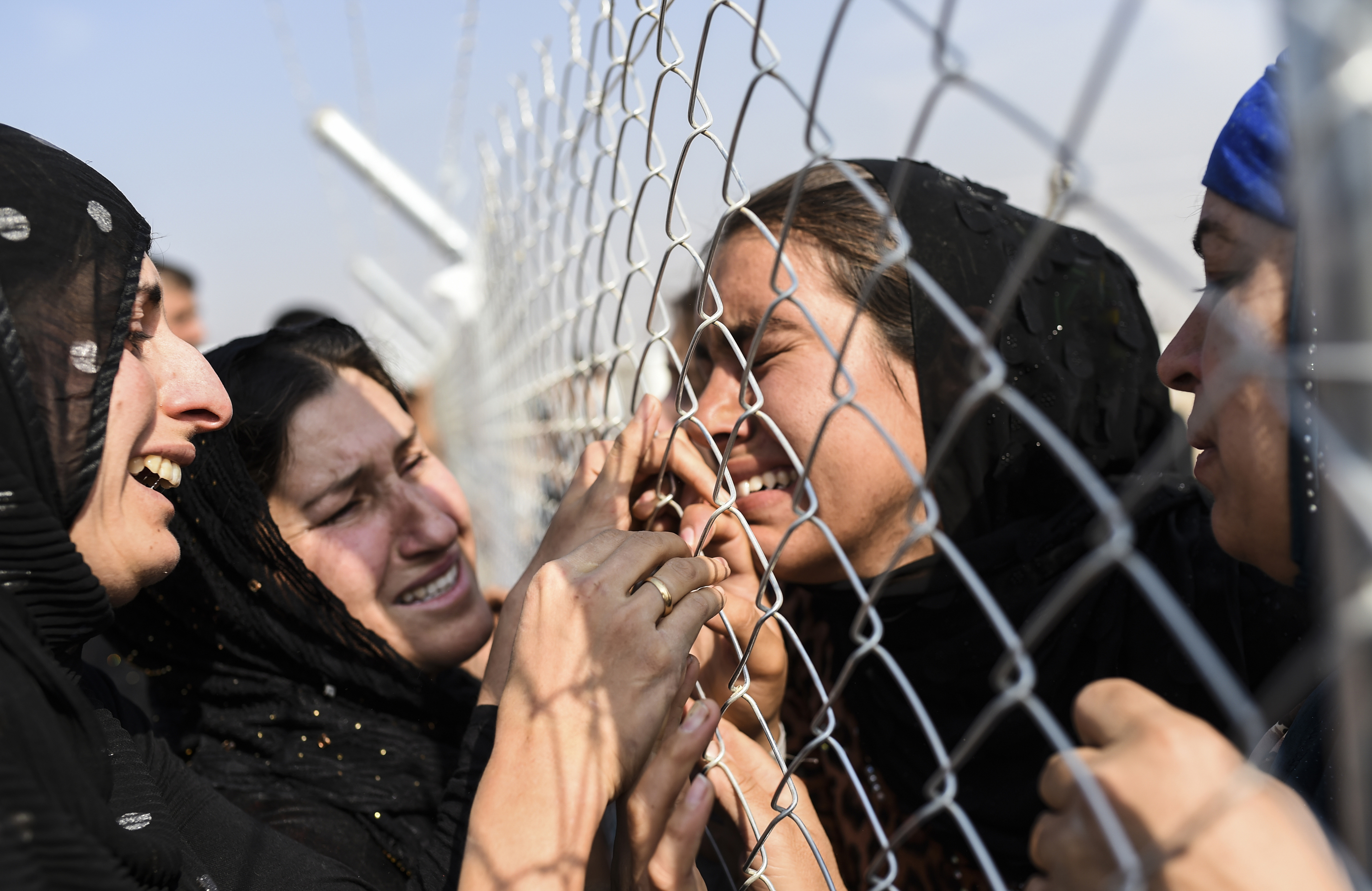 Newly displaced Iraqi's who fled from the city of Mosul, Iraq's last major Islamic State (IS) group stronghold, are reunited with their relatives who came two years ago to the refugee camp in the Khazer area, near near the Kurdish checkpoint of Aksi ...