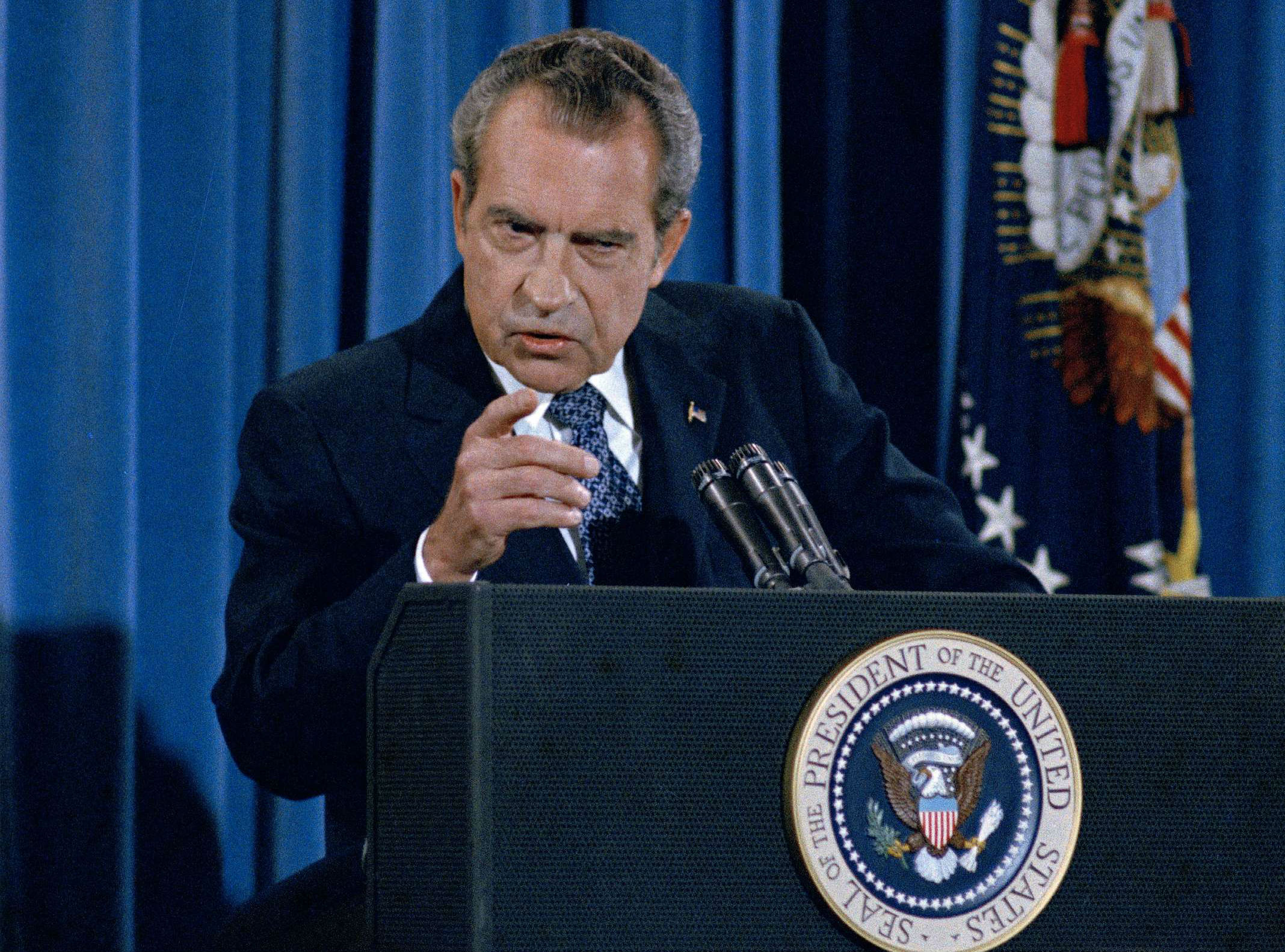 President Richard Nixon gestures sternly during a press conference in Washington in 1973.