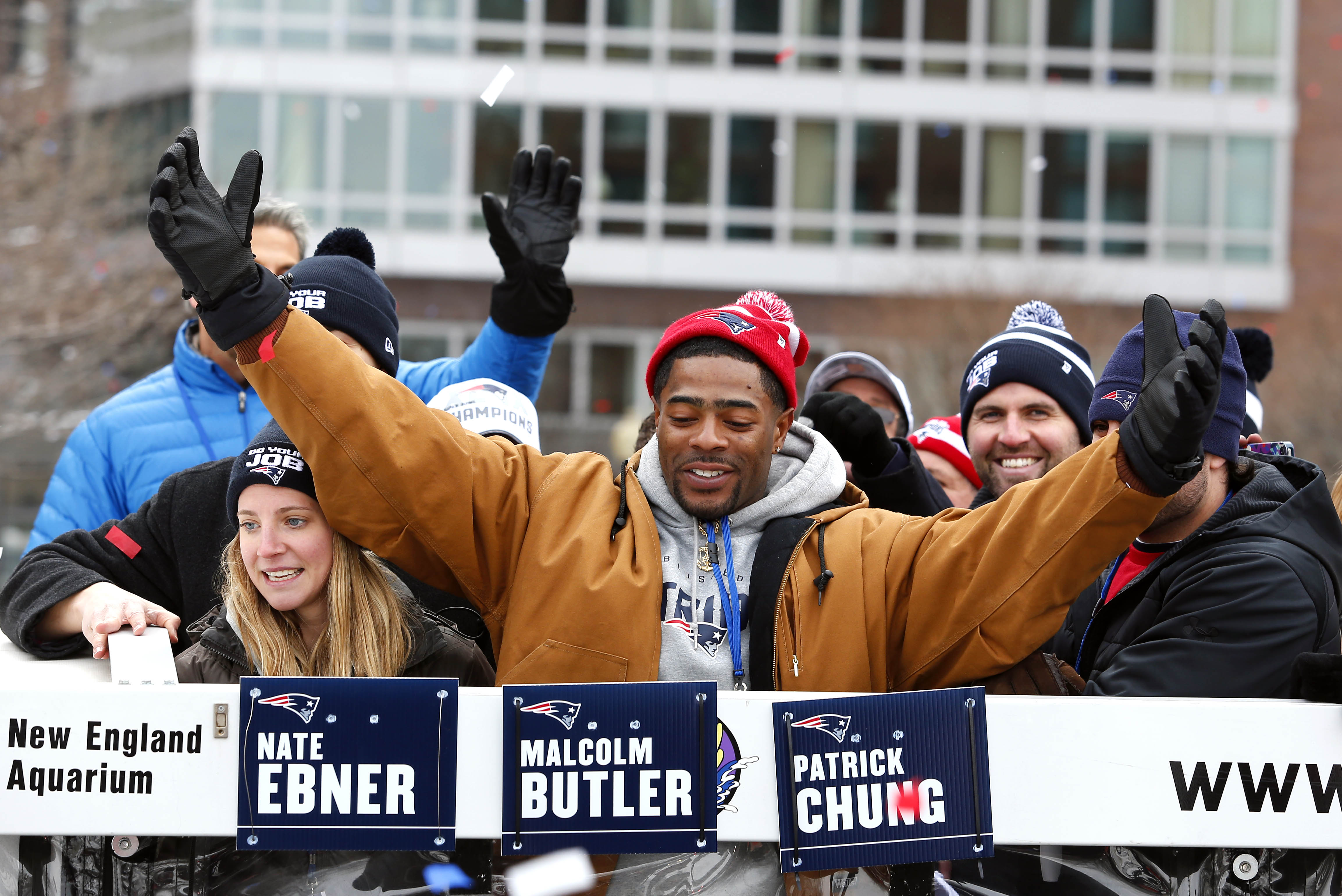 New England safety Malcolm Butler, whose final-minute pass interception sealed the victory for his team, celebrates with parade spectators, Feb. 4, 2015,