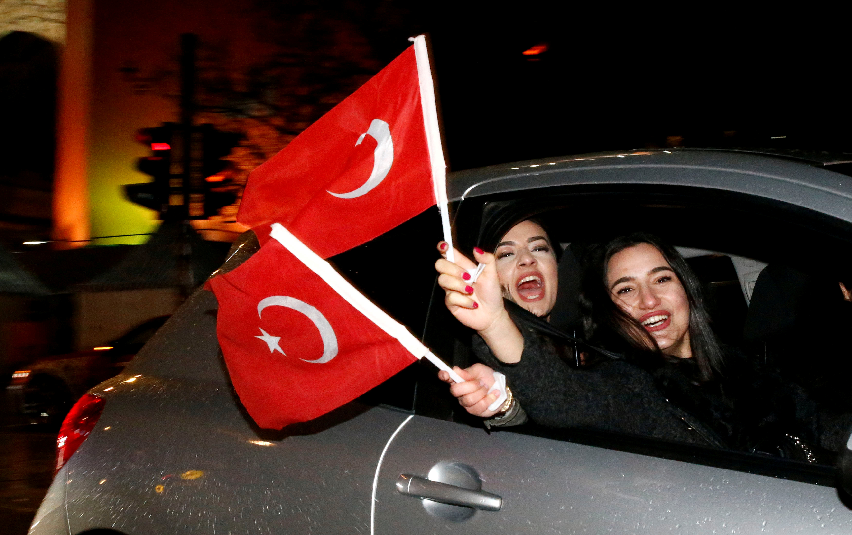 FILE - People of the Turkish community living in Germany, supporting Turkish President Tayyip Erdogan, celebrate on Kurfuerstendamm boulevard after news bulletins on the outcome of Turkey's referendum on the constitution, in Berlin, April 16, 2017.