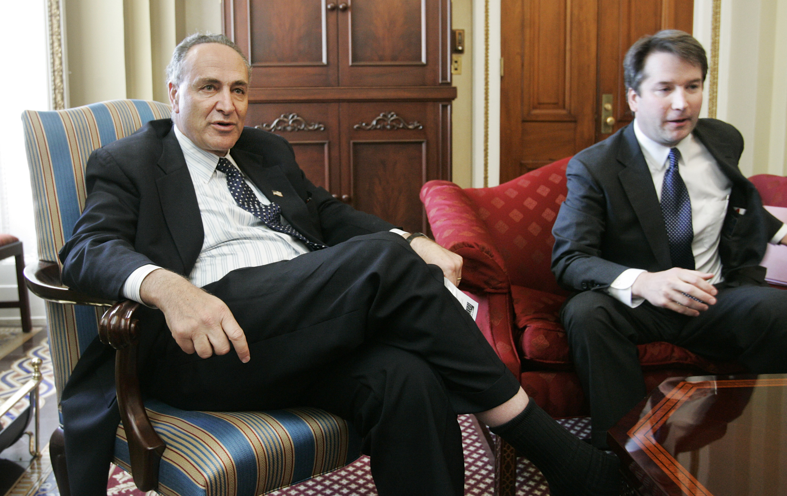 FILE - Sen. Charles Schumer, D-N.Y., meets with Brett Kavanaugh, right, then-nominee for the D.C. Circuit Court, on Capitol Hill, May 2, 2006.
