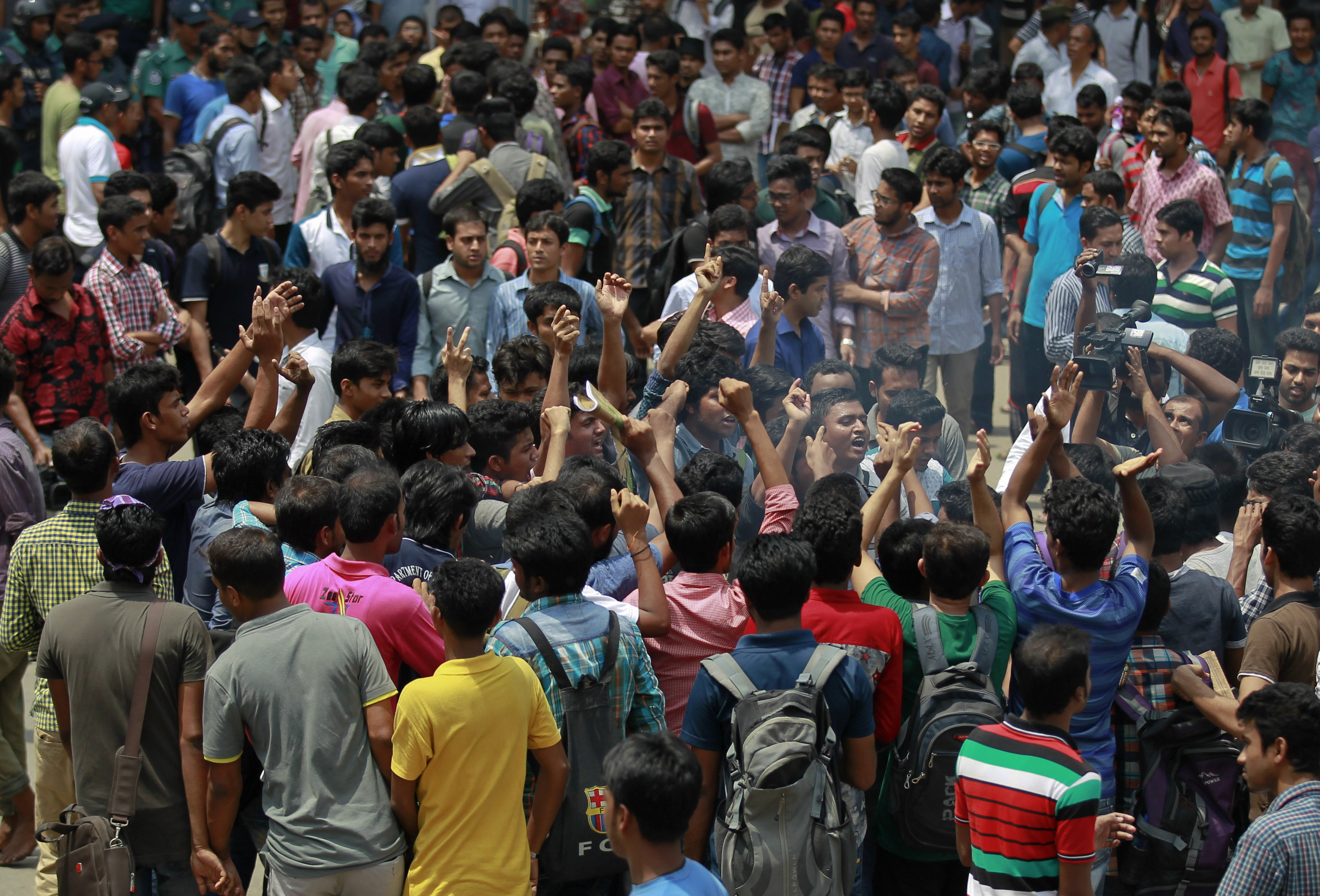 Students protest seeking the arrest of three motorcycle-riding assailants who hacked and shot student activist Nazimuddin Samad to death as he walked with a friend, in Dhaka, Bangladesh, April 7, 2016.