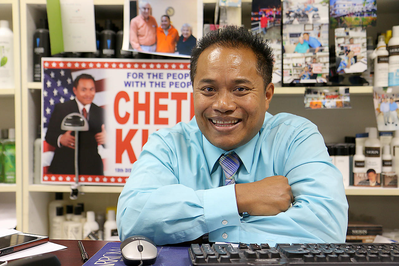 Cheth Khim, a state representative candidate for the 18th Middlesex House seat, at his office on Middlesex Street. (Photo courtesy of Sun/John Love)