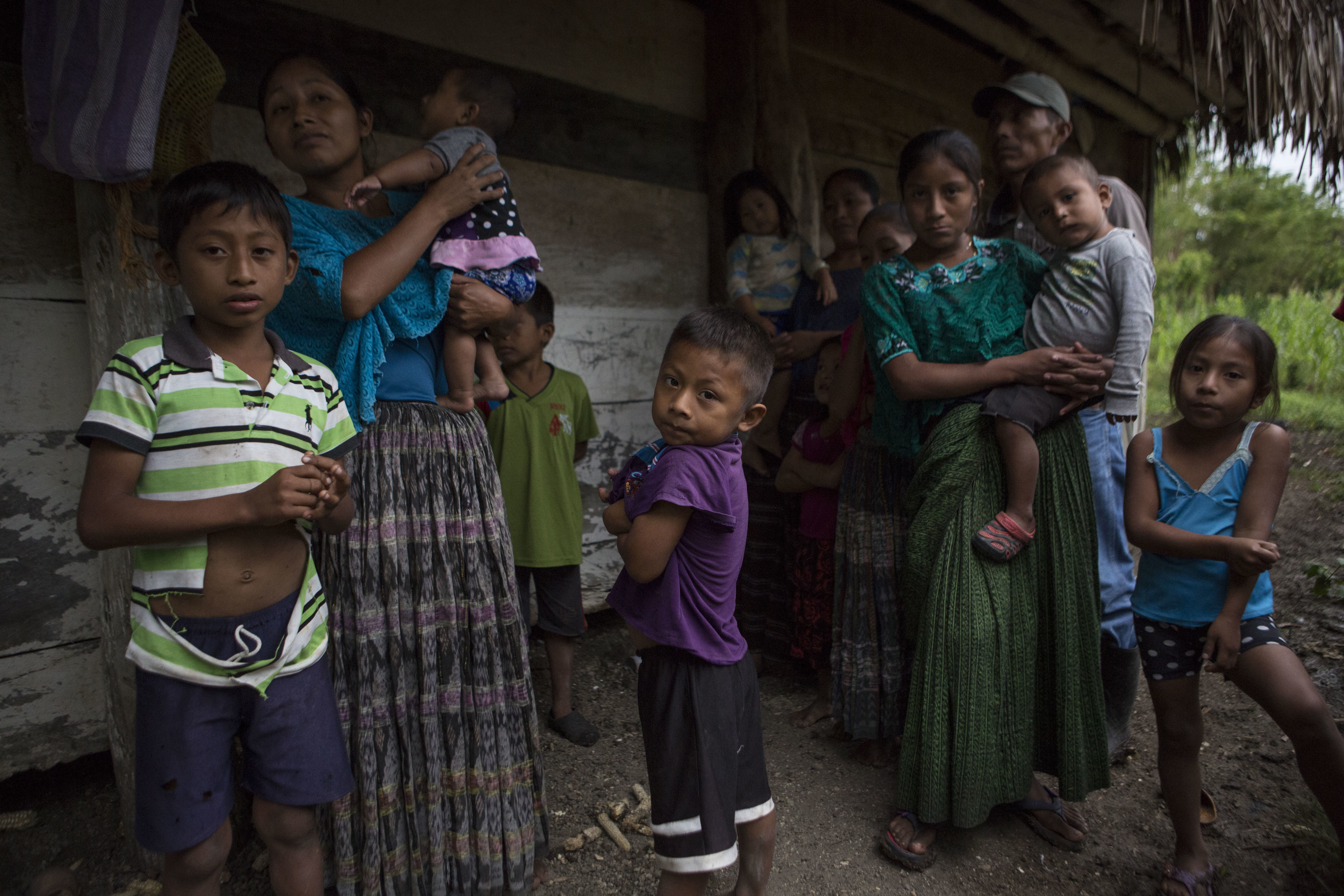 Members of the Caal Maquin family and neighbors stand in front of Claudia Maquin's house in Raxruha, Guatemala, Dec. 15, 2018. Claudia Maquin's daughter, 7-year-old Jakelin CaalMaquin, died in a Texas hospital, two days after being taken into custo...