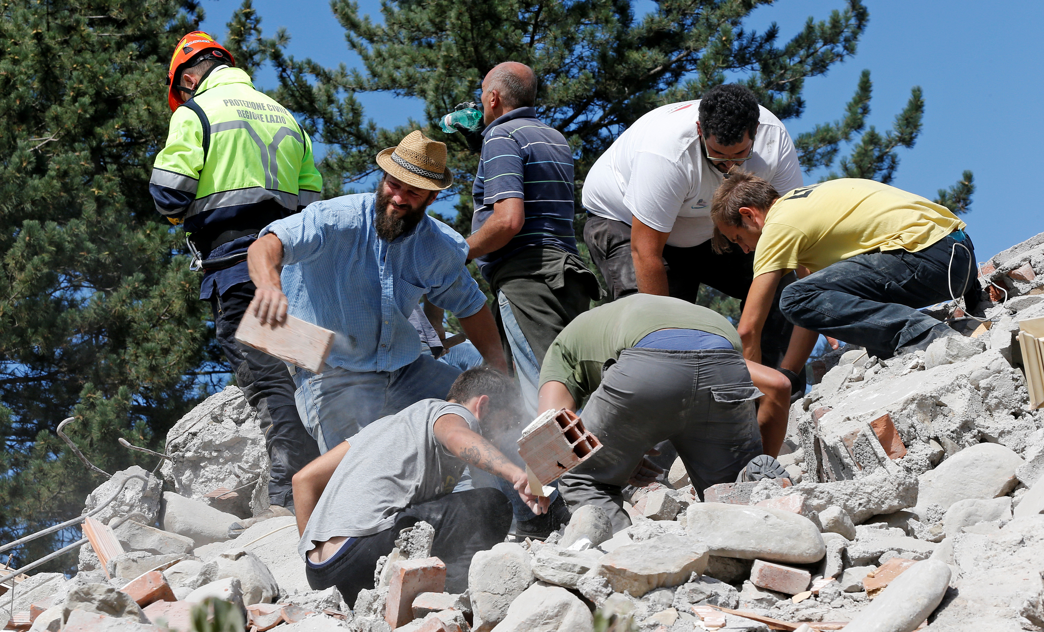 Rescuers work on a collapsed building following an earthquake in Amatrice, central Italy, Aug. 24, 2016.
