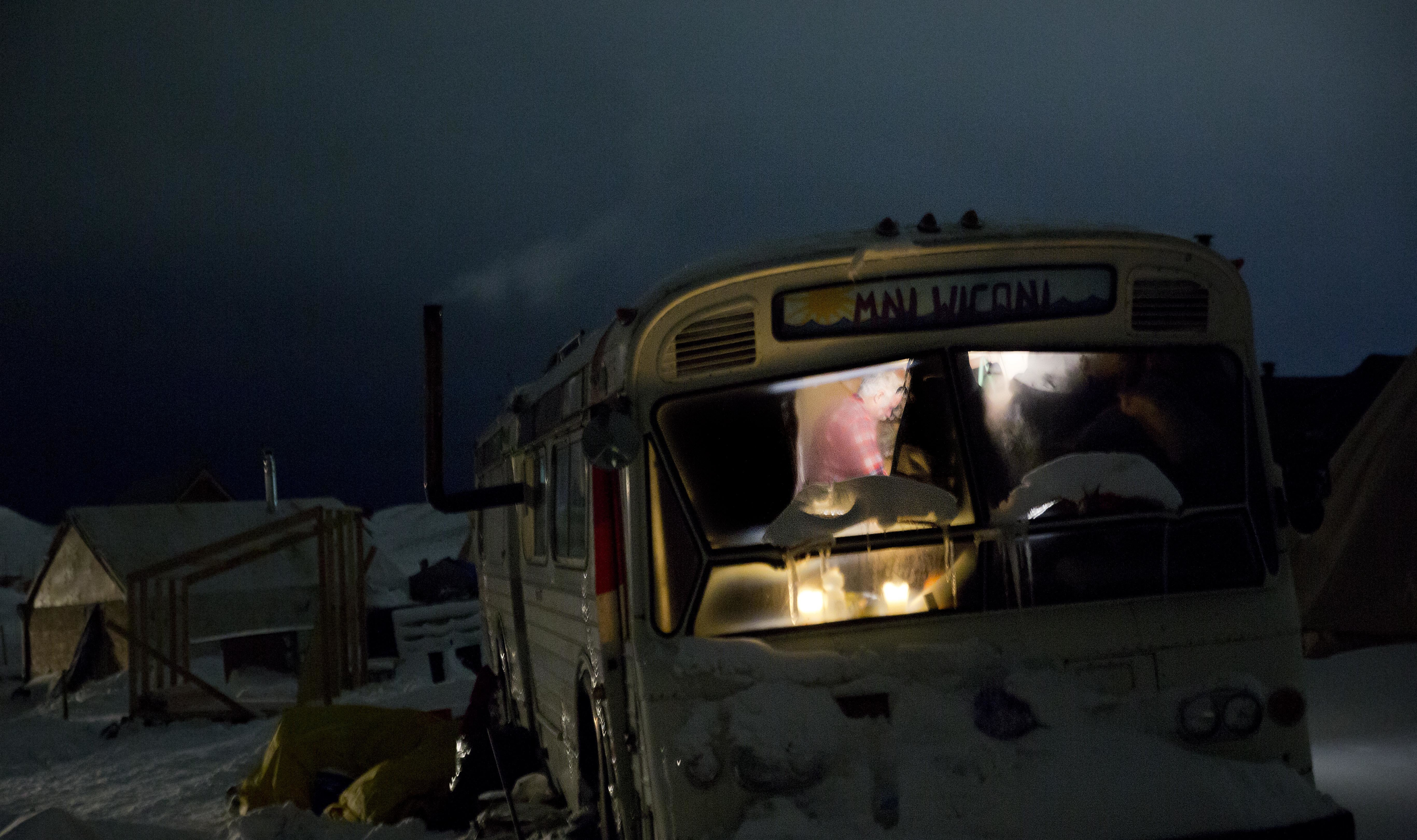A bus has become a camper at the Oceti Sakowin camp, where people have gathered to protest the Dakota Access pipeline near Cannon Ball, N.D., Nov. 30, 2016. The camp covers a half square mile, with living quarters that include old school buses, fancy...