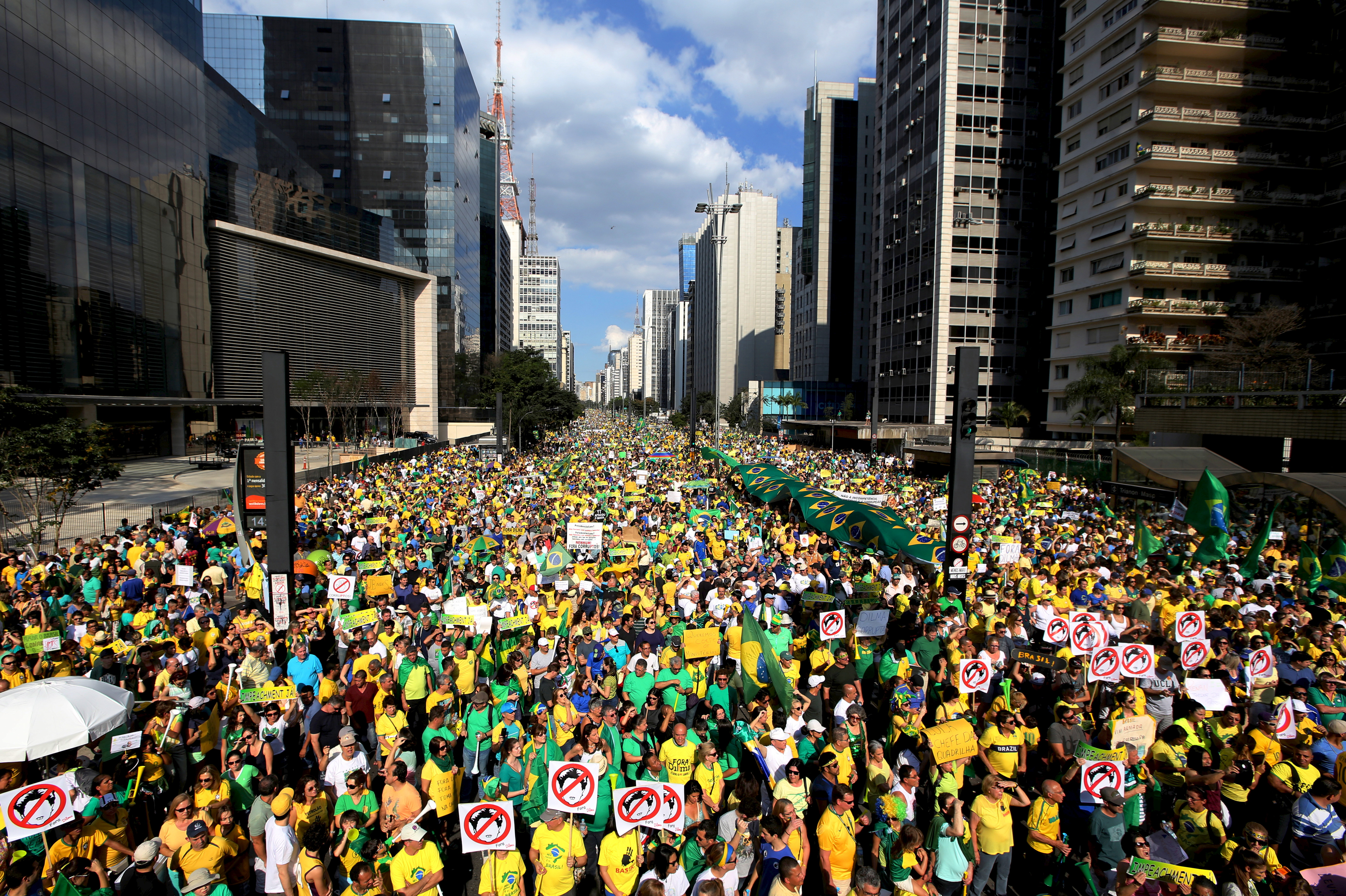 Demonstrators attend a protest against Brazil's President Dilma Rousseff, part of nationwide protests calling for her impeachment, at Paulista Avenue in Sao Paulo's financial centre, Brazil, August 16, 2015.