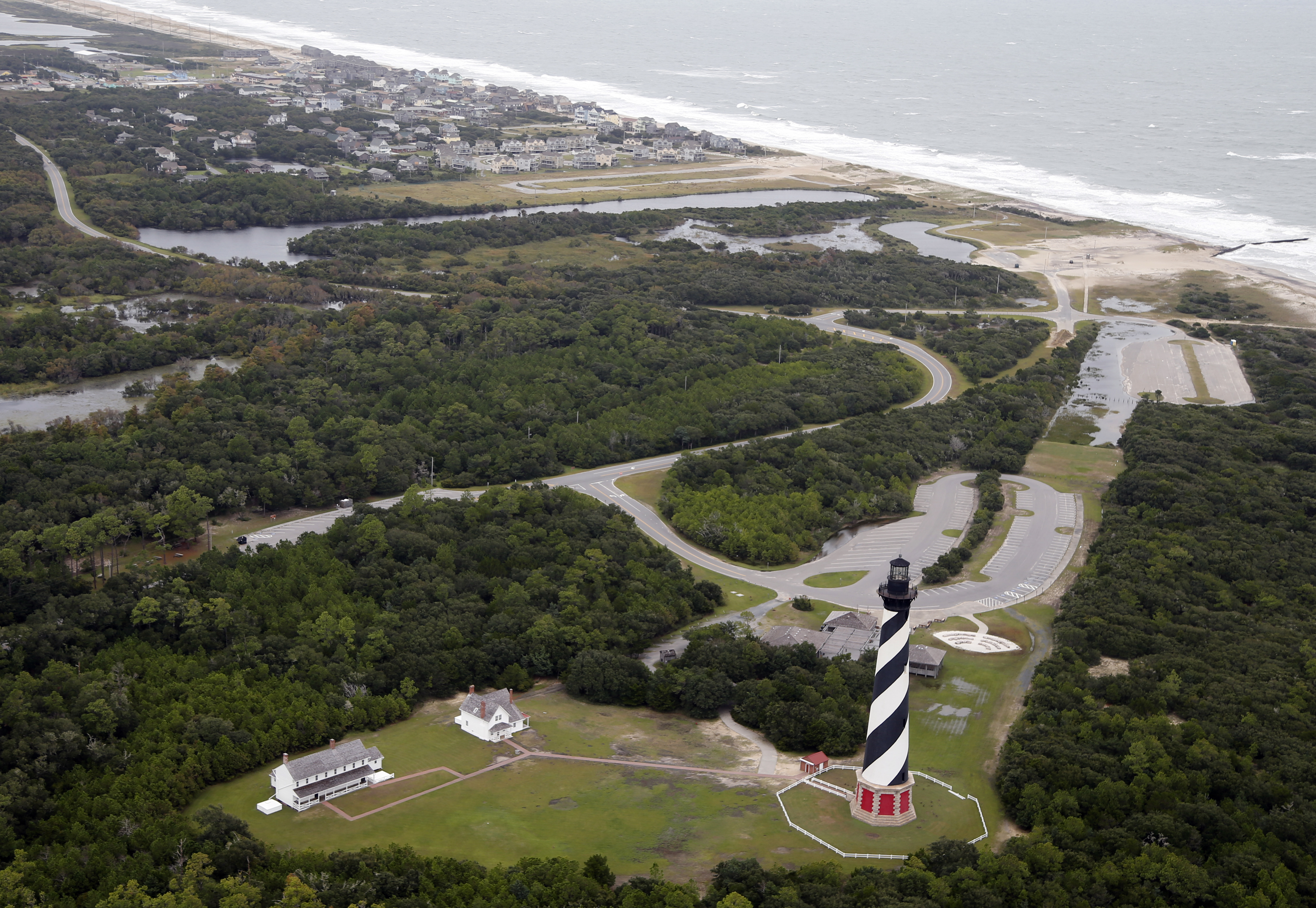 The Cape Hatteras lighthouse sits way off the beach in Buxton, N.C., Sept. 15, 2018. It was moved 2,900 feet inland in 1999.