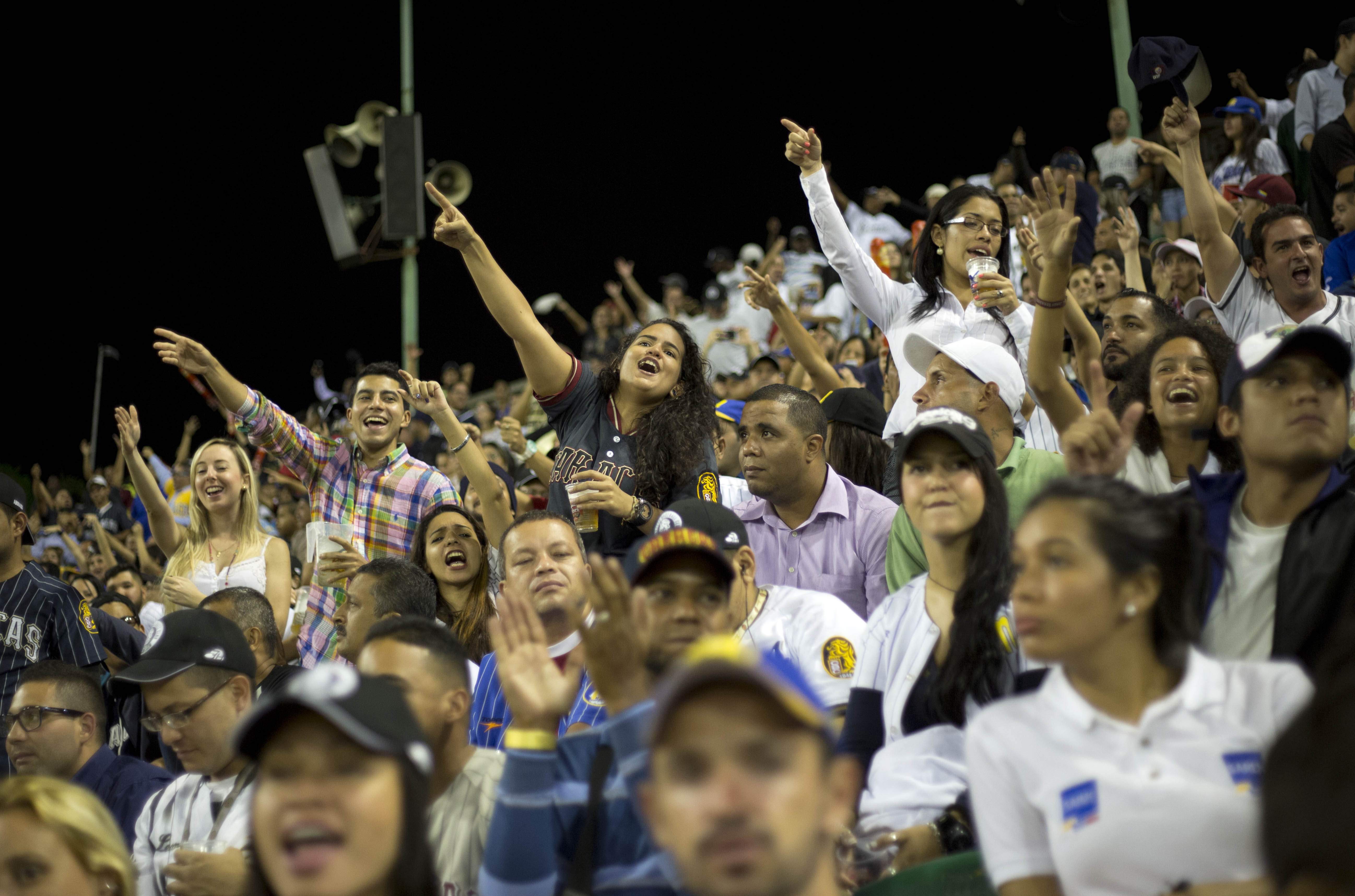 While most South Americans prefer soccer, Venezuela is crazy about baseball — even with games becoming more expensive to attend. These fans watch a game between the Leones de Caracas and the Navegantes del Magallanes in Caracas, Oct. 27, 2015.