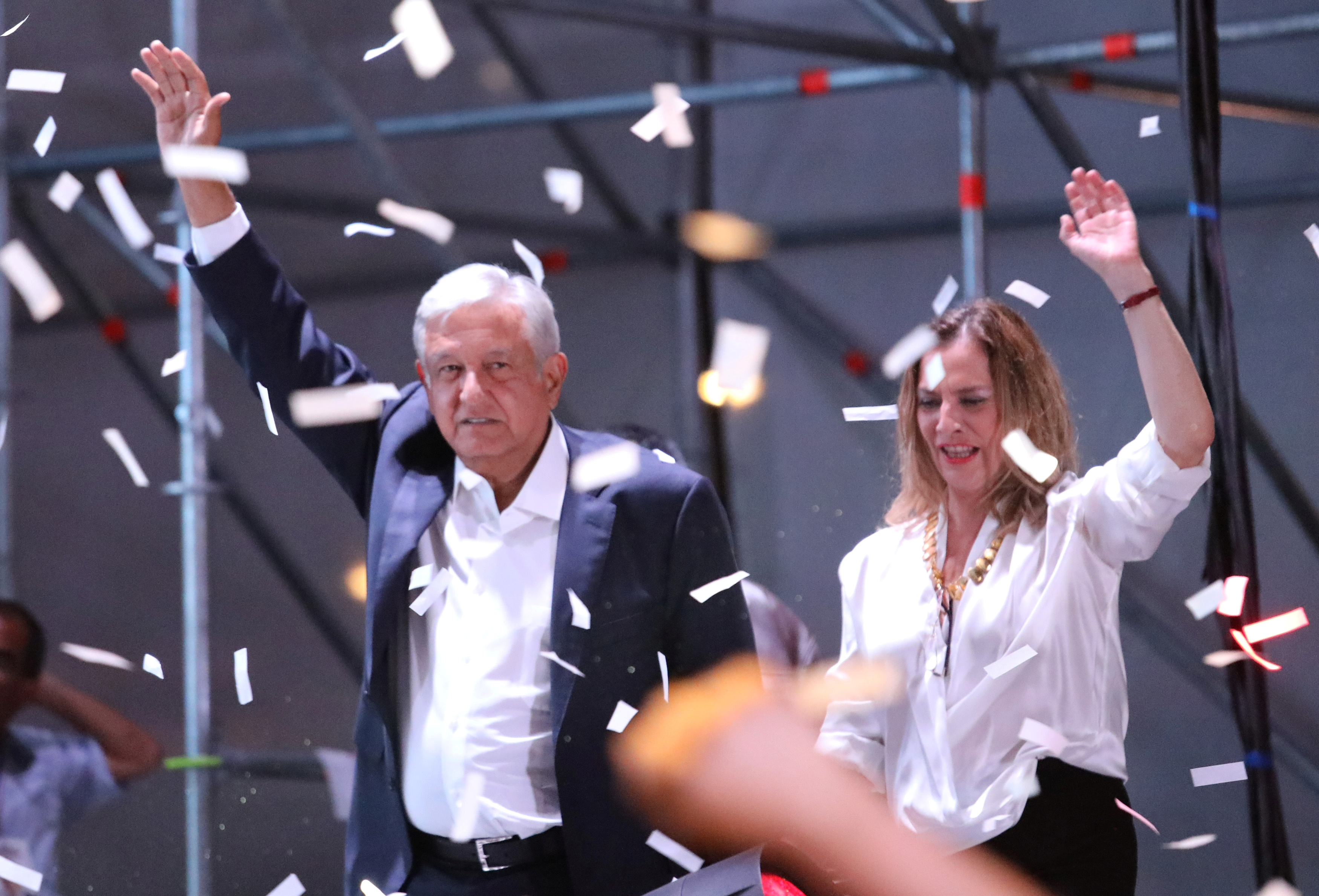 Presidential candidate Andres Manuel Lopez Obrador gestures with his wife Beatriz Gutierrez Muller as he addresses supporters in Mexico City, Mexico, July 1, 2018.