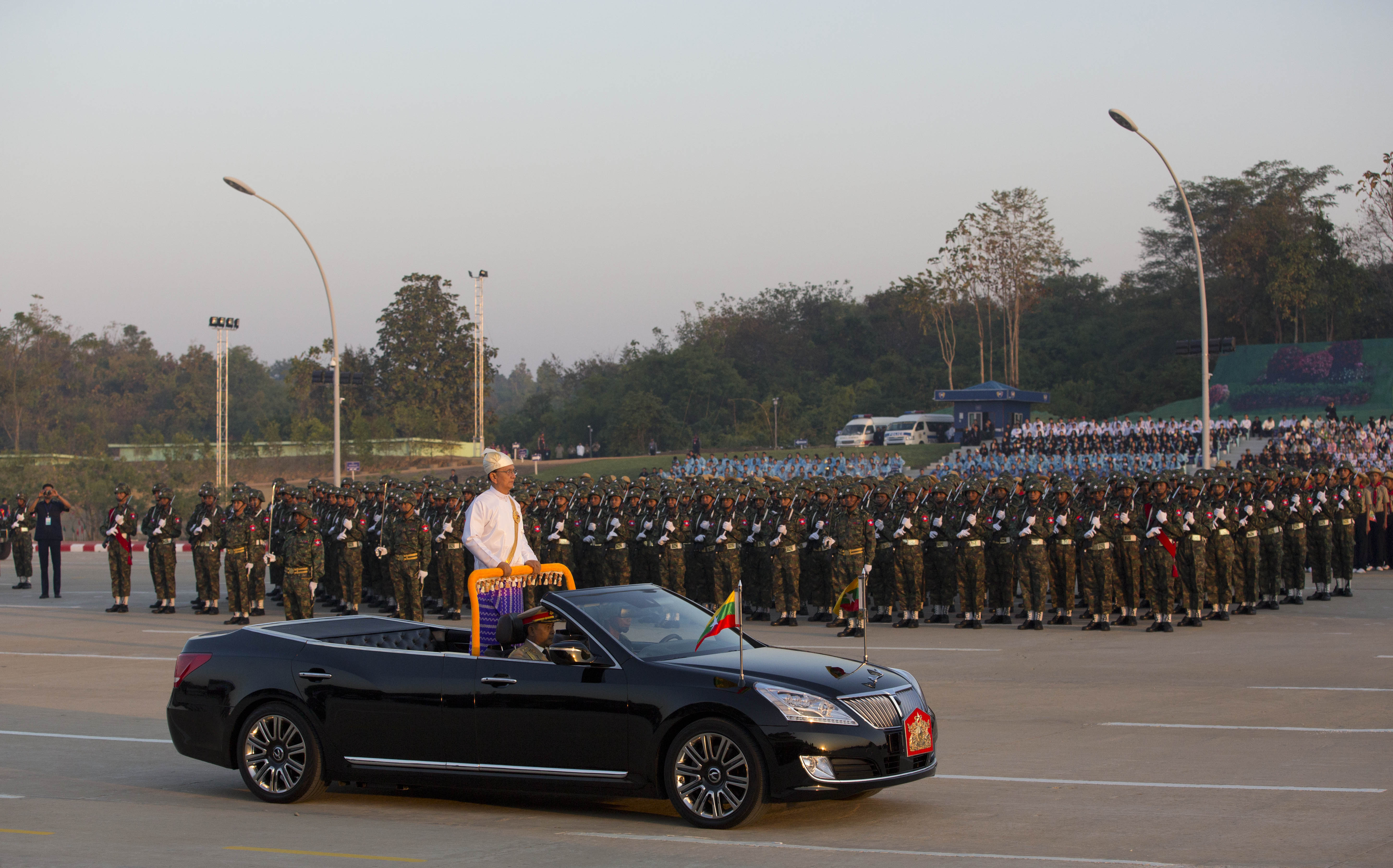 Myanmar's President Thein Sein, standing in an open vehicle, inspect officers and soldiers during a ceremony to mark the 67th anniversary of Independence Day in Naypyitaw, Jan. 4, 2015.