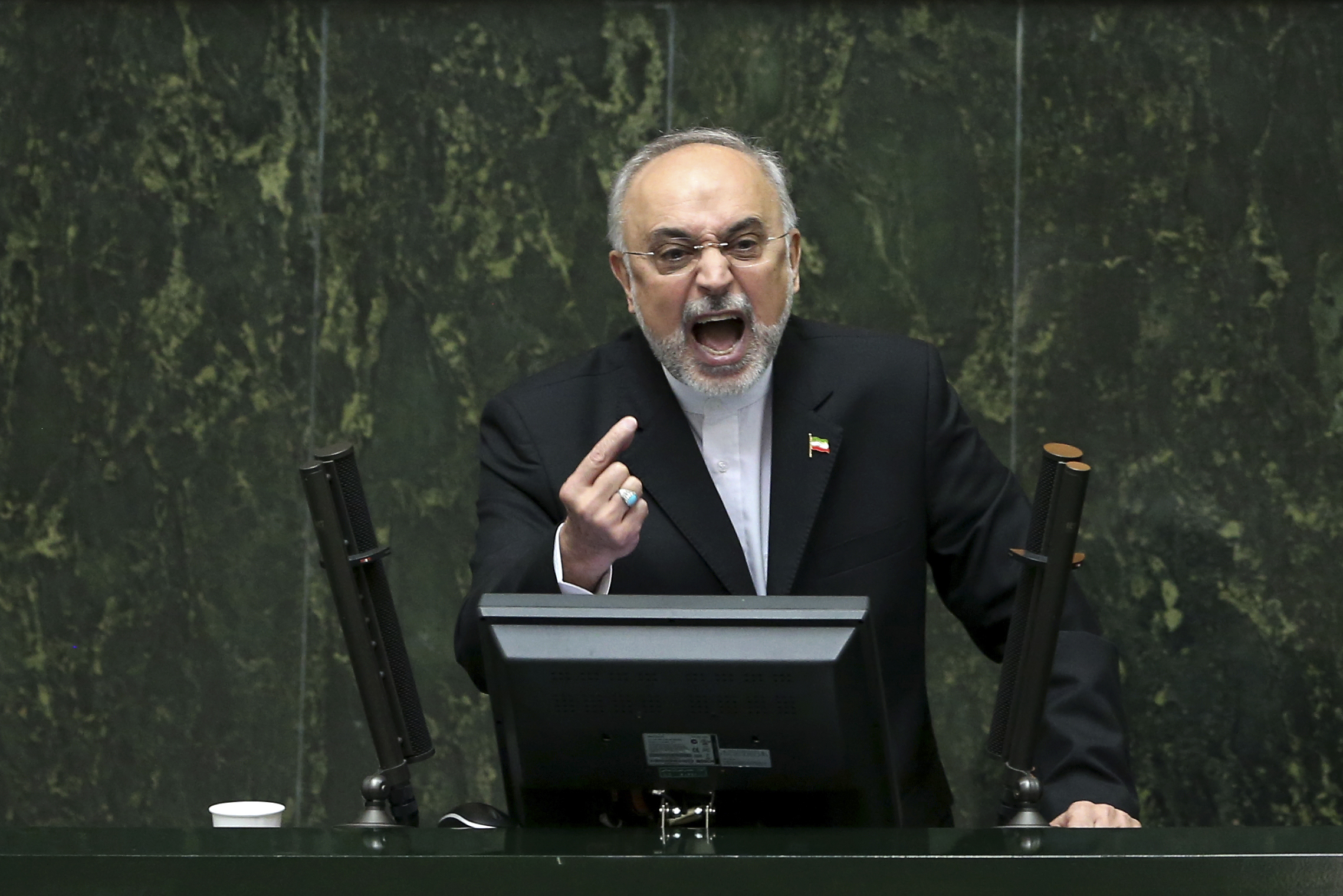 Head of Iran's Atomic Energy Organization Ali Akbar Salehi speaks in an open session of parliament while discussing a bill on Iran's nuclear deal with world powers, in Tehran, Iran, Oct. 11, 2015.