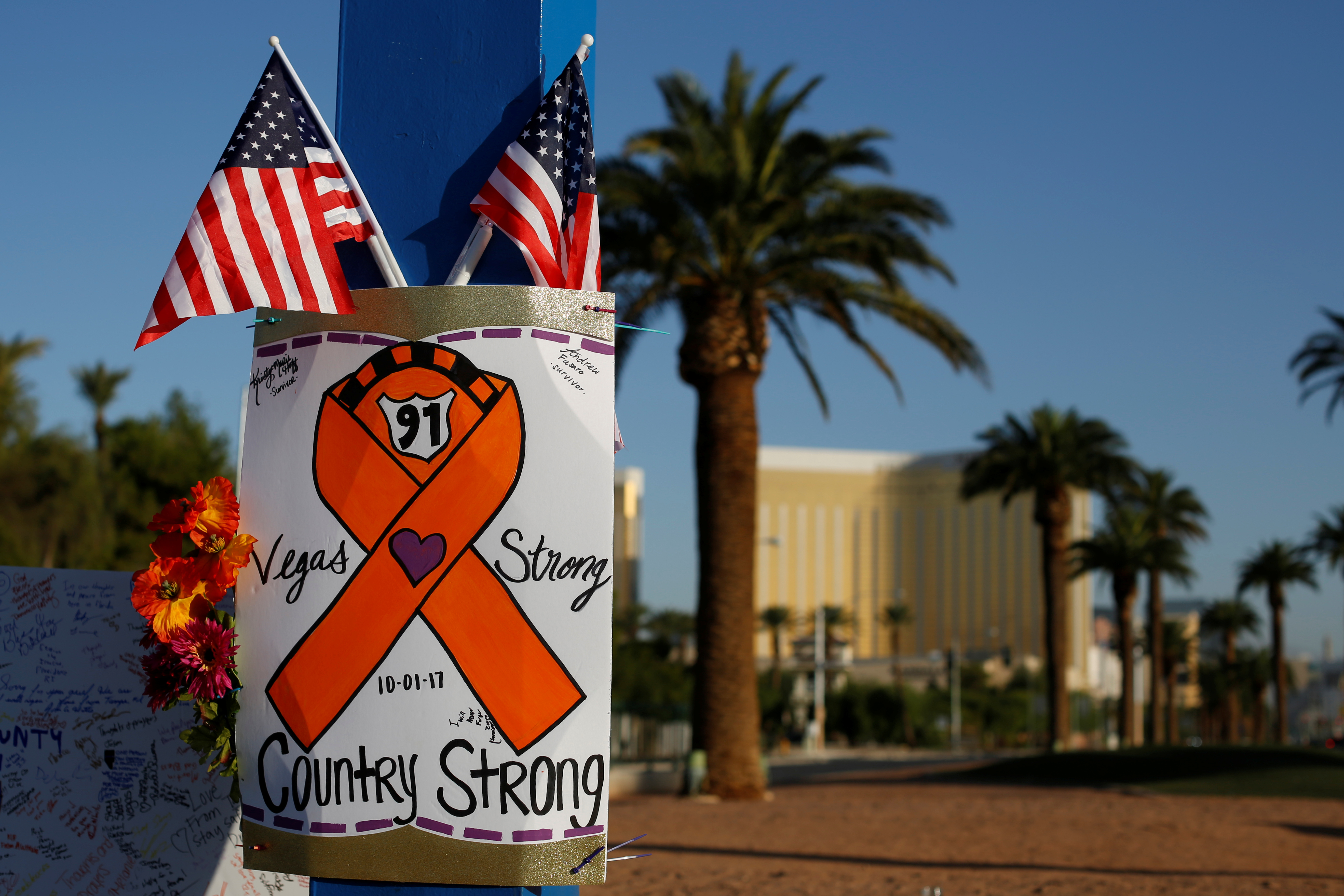 A sign is pictured at a makeshift memorial in the middle of Las Vegas Boulevard following the mass shooting in Las Vegas, Nevada, Oct. 4, 2017.