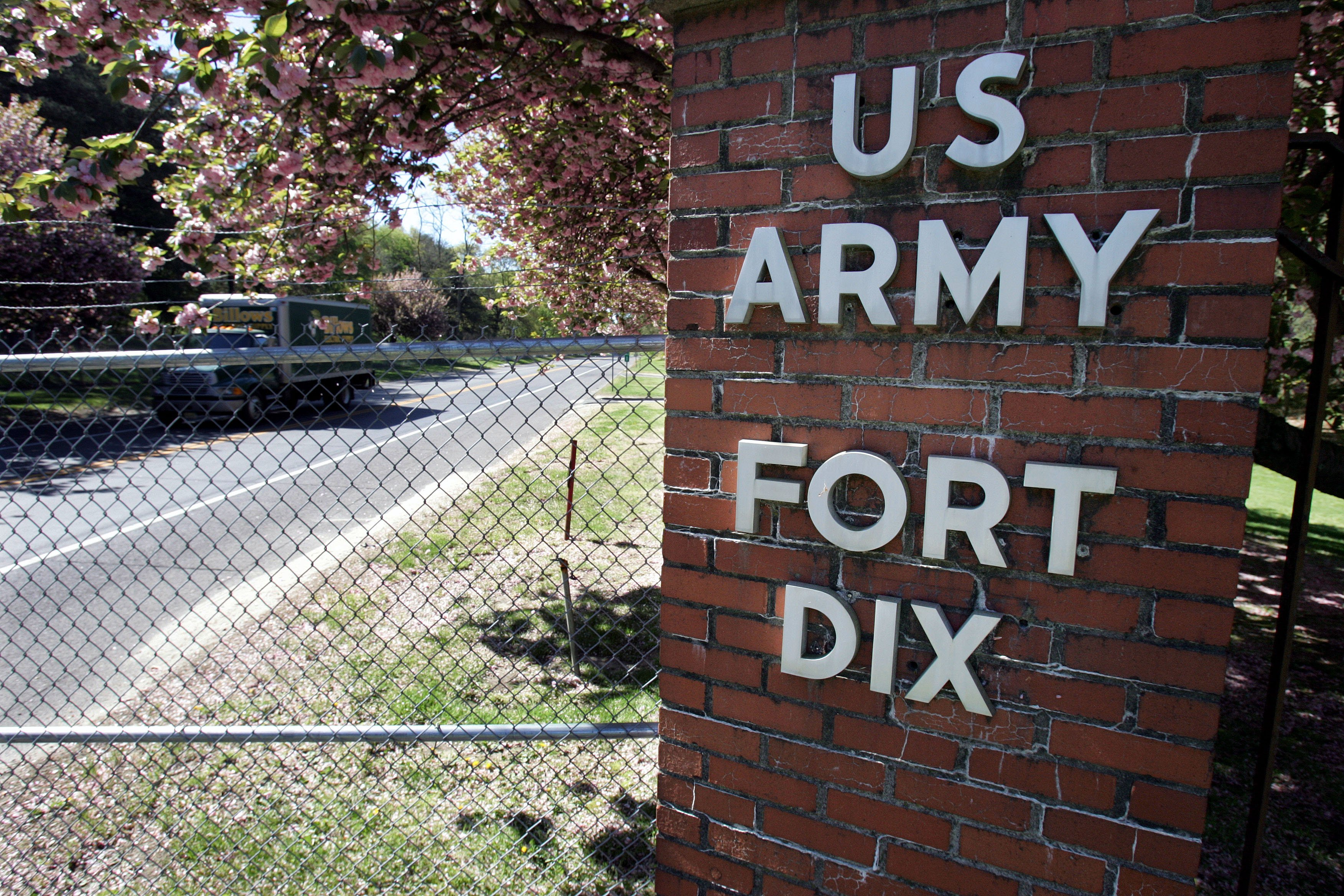 FILE - A truck drives through a gate at the Fort Dix Army Base near Wrightstown, N.J., May 8, 2007.