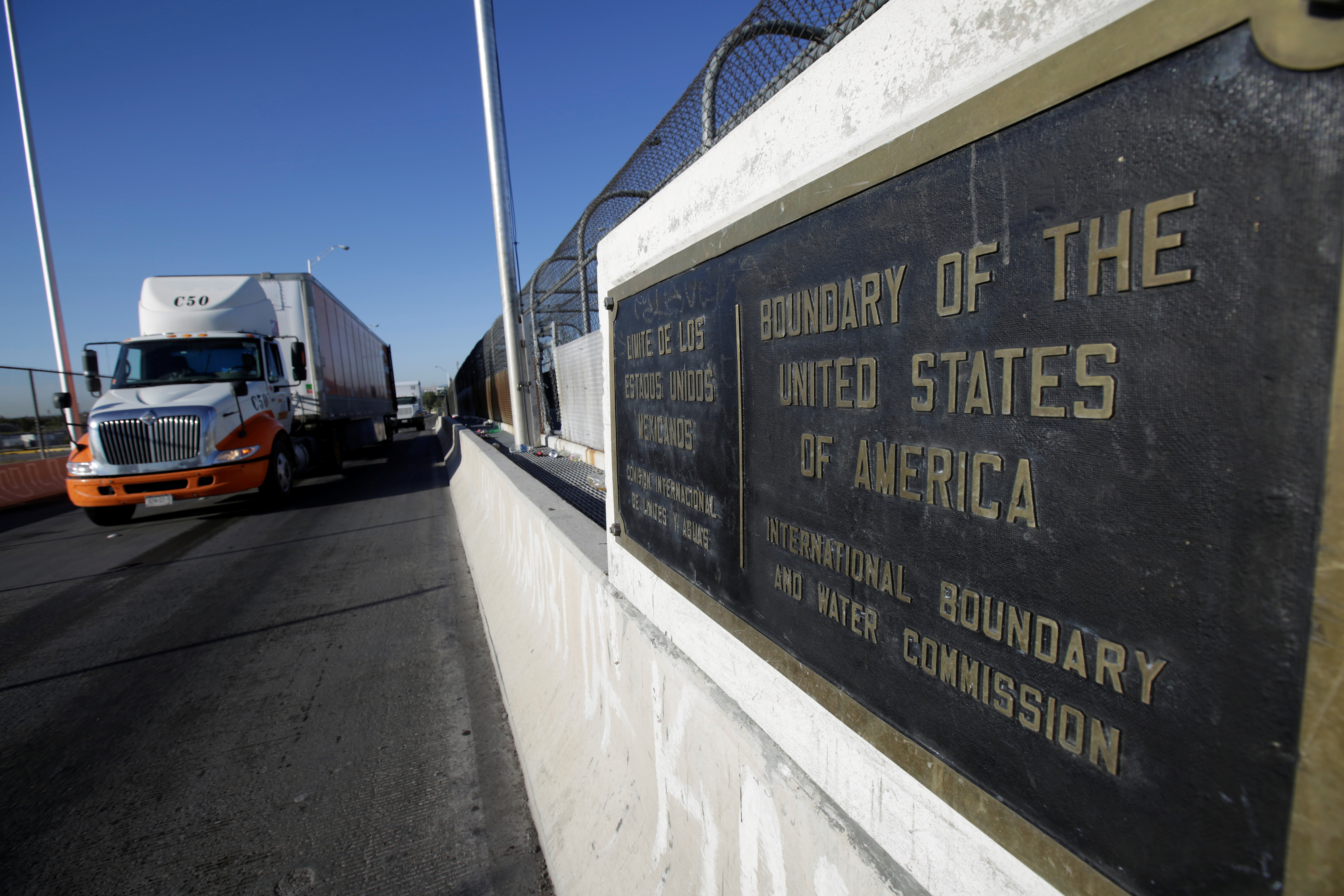 Trucks wait in the queue for border customs control to cross into U.S. at the Bridge of Americas in Ciudad Juarez, Mexico, Aug. 15, 2017.