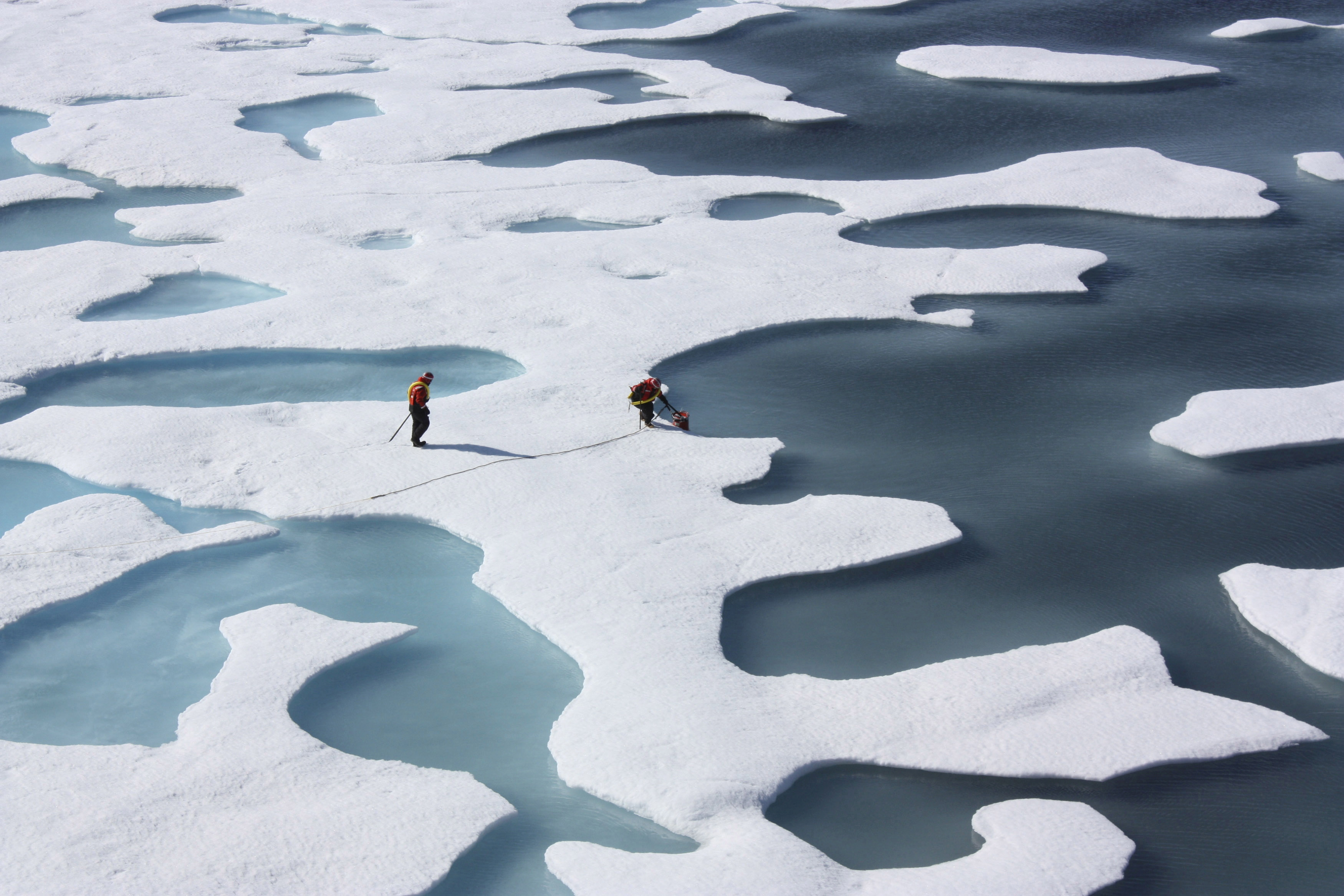 FILE - The crew of the  U.S. Coast Guard Cutter Healy, in the midst of their ICESCAPE mission to study sea ice, retrieves supplies in the Arctic Ocean, July 12, 2011.