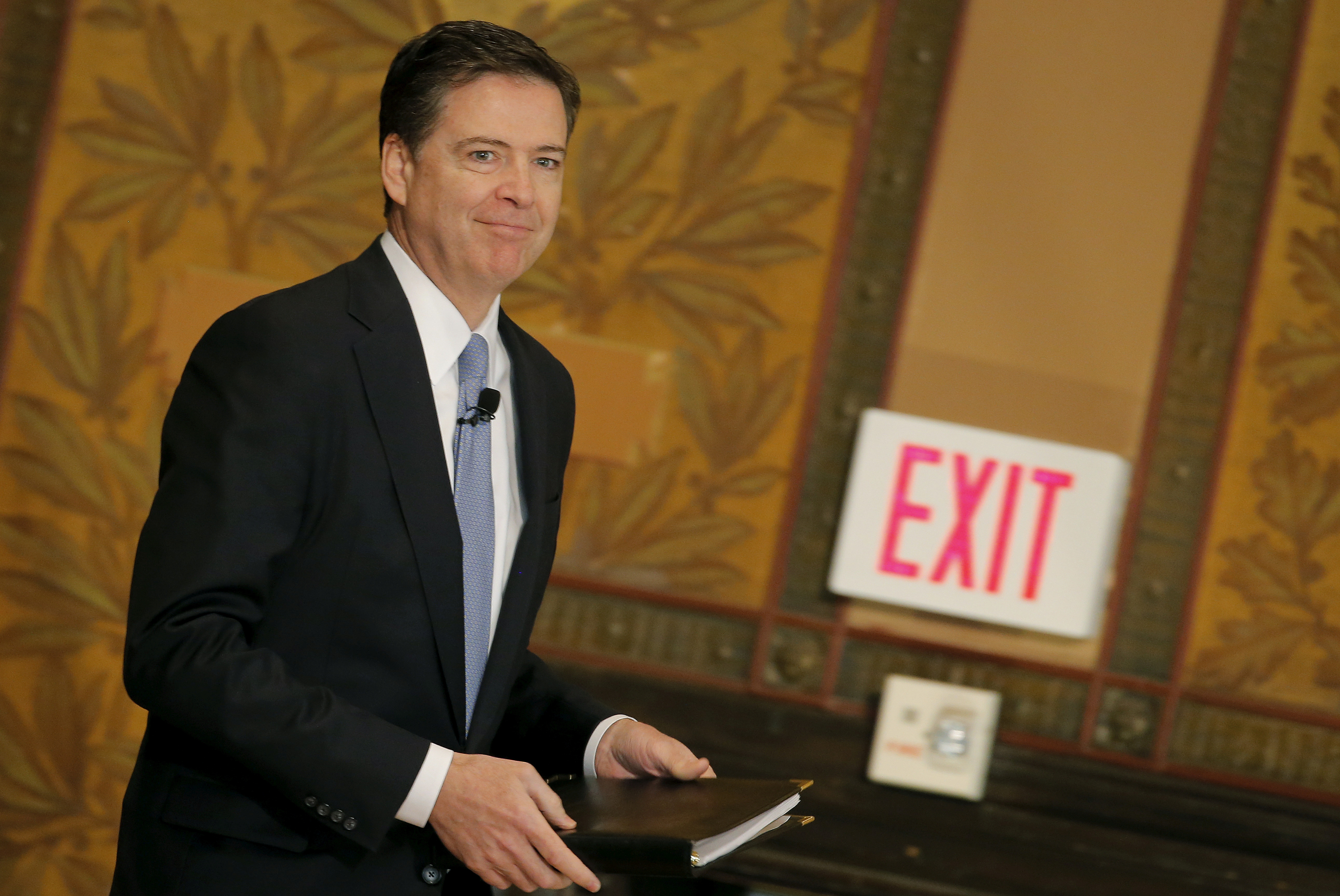 FILE - FBI Director James Comey arrives to deliver a speech at the Master of Science in Foreign Service CyberProject's sixth annual conference at Georgetown University in Washington D.C., April 26, 2016.