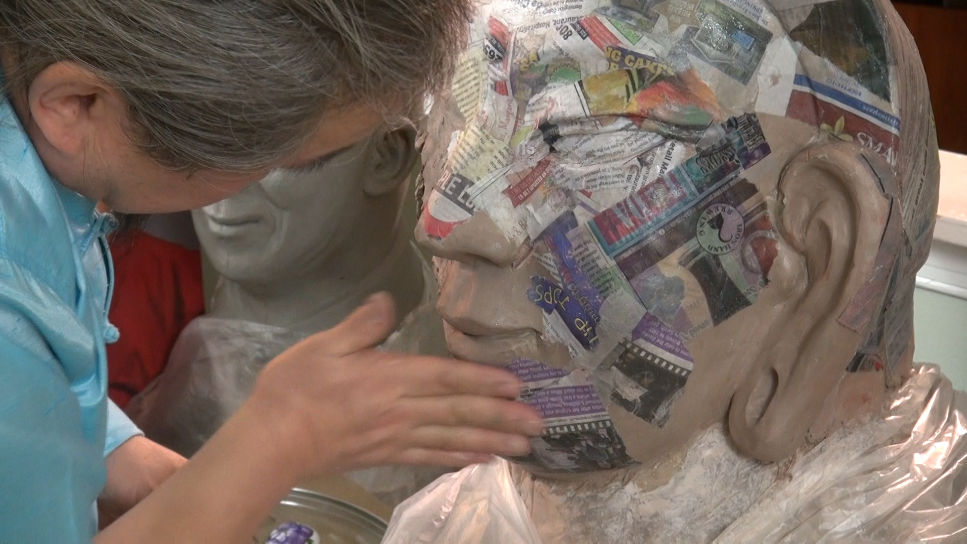 "The masks are made of many layers of paper mache laid over a clay form. Each one takes a month to make. But Ganna loves the process which he says allows ""for a peaceful life."""