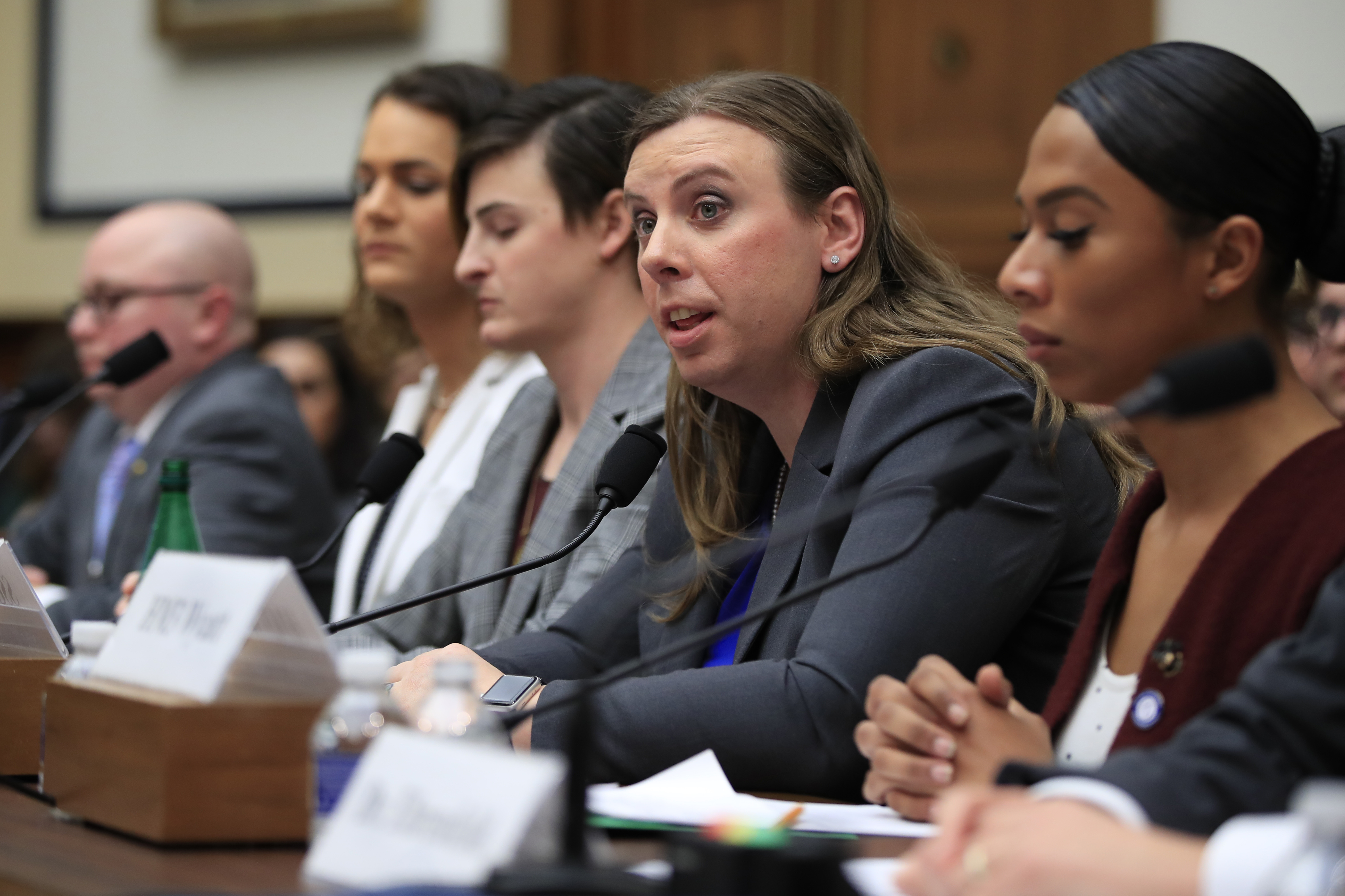 FILE - Army Staff Sgt. Patricia King, second from right, together with other transgender military members testify about their military service before a House Armed Services Subcommittee on Military Personnel hearing on Capitol Hill in Washington, Feb