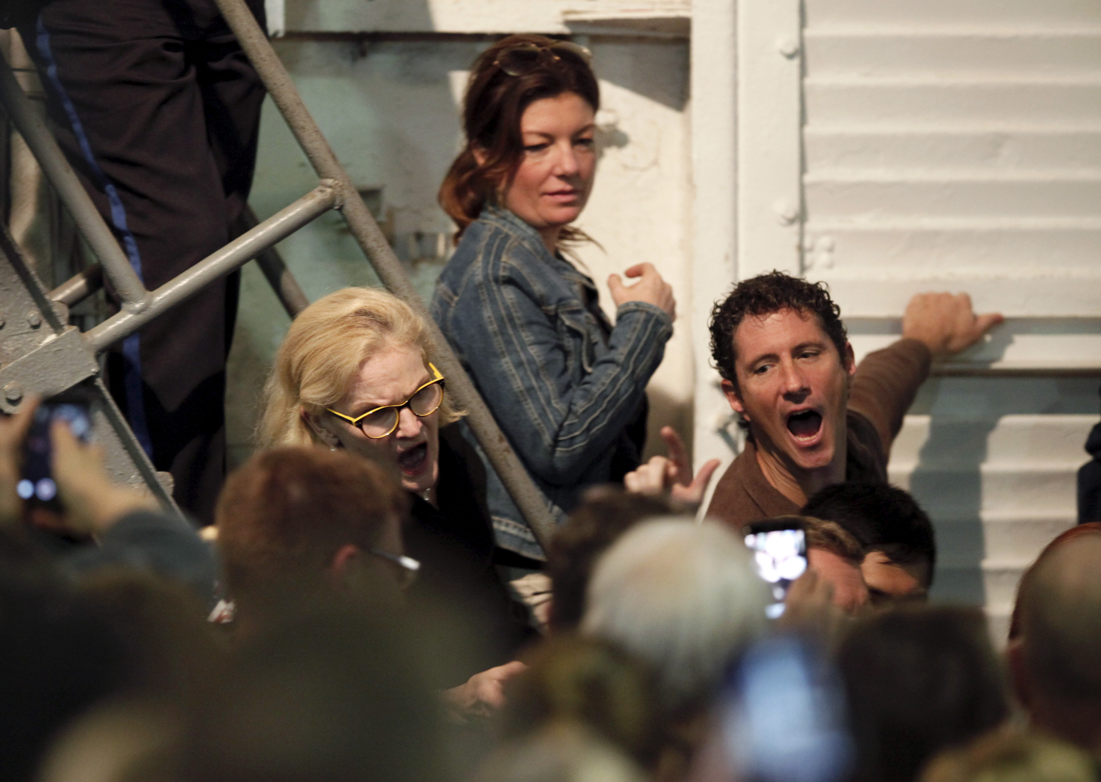 Trump supporters yell at passing protesters (unseen), who are against Trump's policies, during a rally by U.S. Republican presidential candidate Donald Trump aboard the USS Yorktown Memorial in Mount Pleasant, S.C., Dec. 7, 2015.