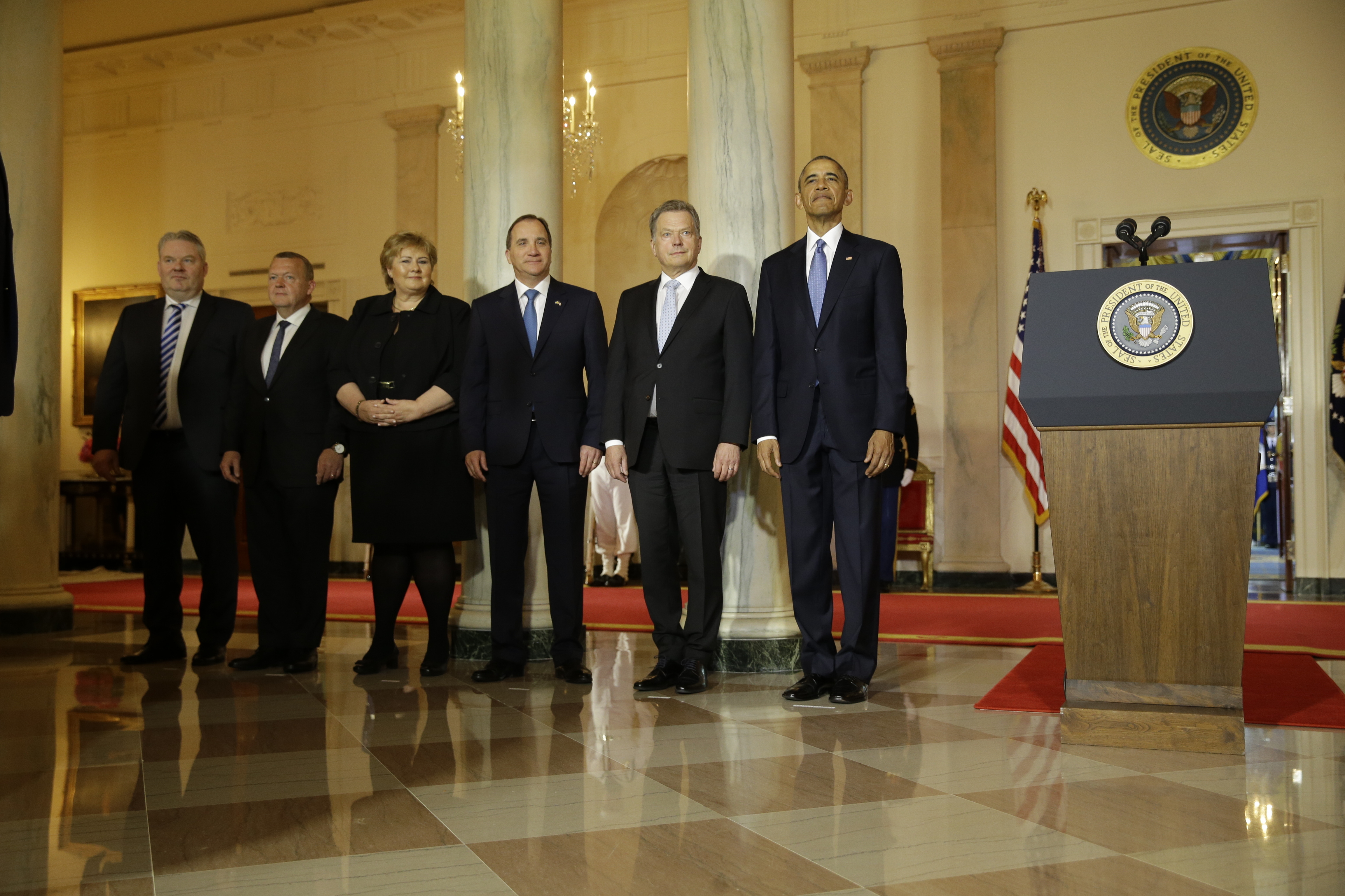 President Barack Obama stands with, from left, Iceland's PM Sigurdur Ingi Johannsson, Denmark's PM Lars Lokke Rasmussen, Norwegian PM Erna Solberg, Sweden's PM Stefan Lofven and Finnish President Sauli Niinisto at the outset of the Nordic summit at t...