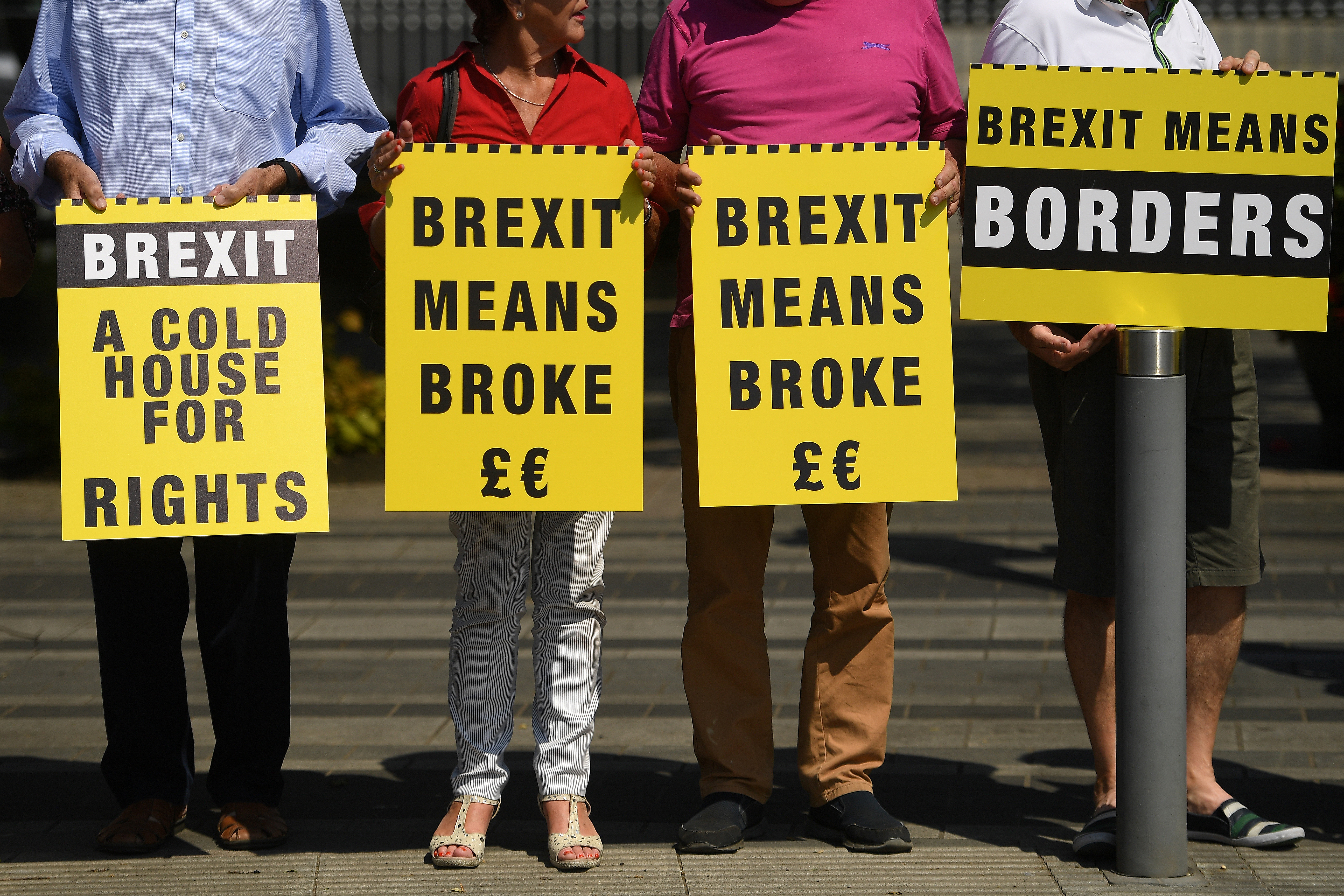 FILE - Activists with the group 'Borders Against Brexit' protest in the border town of Dundalk, Ireland, June 28, 2018.