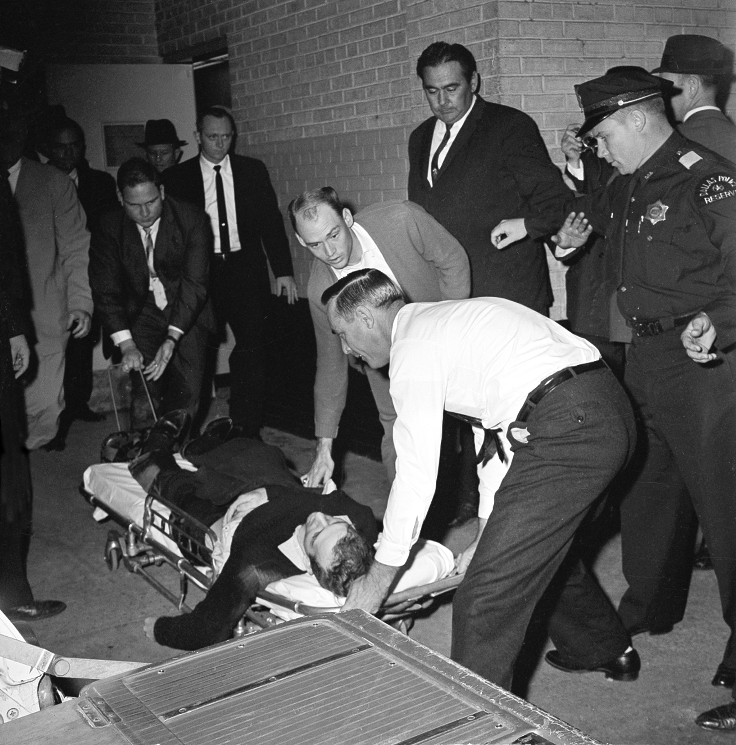 Lee Harvey Oswald, accused assassin of President John F. Kennedy, is placed on a stretcher after being shot in the stomach in Dallas, Texas, Nov. 24, 1963.