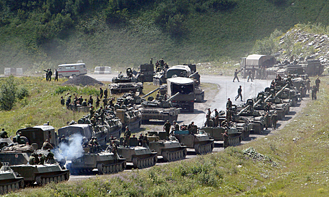 A column of Russian armored vehicles on its way to the South Ossetian capital Tskhinvali in the Georgian breakaway region, South Ossetia, August 9, 2008 file photo