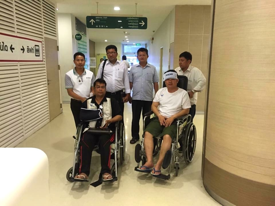 Cambodian opposition​ CNRP lawmakers Nhay Chamroeun and Kong Saphea are seen in wheelchairs at Phyathai hospital in Bangkok on Tuesday, October 27, 2015 after being beaten by protesters in Phnom Penh, Cambodia on Monday. (Courtesy of Nhay Chamroeun...