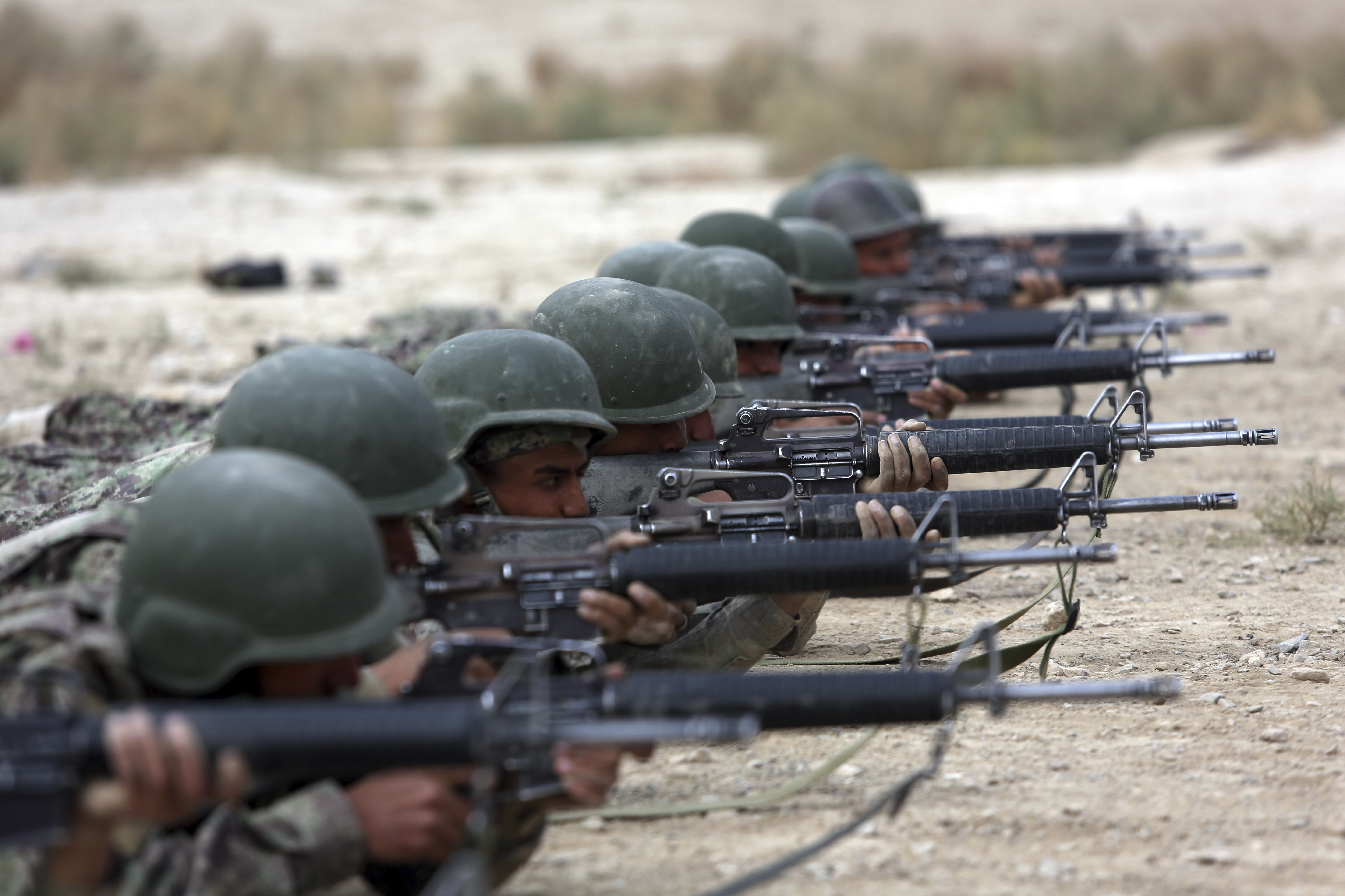 FILE - In this Oct. 31, 2018, file photo, Afghan National Army soldiers participate in a live fire training exercise, at the Afghan Military Academy, in Kabul, Afghanistan.