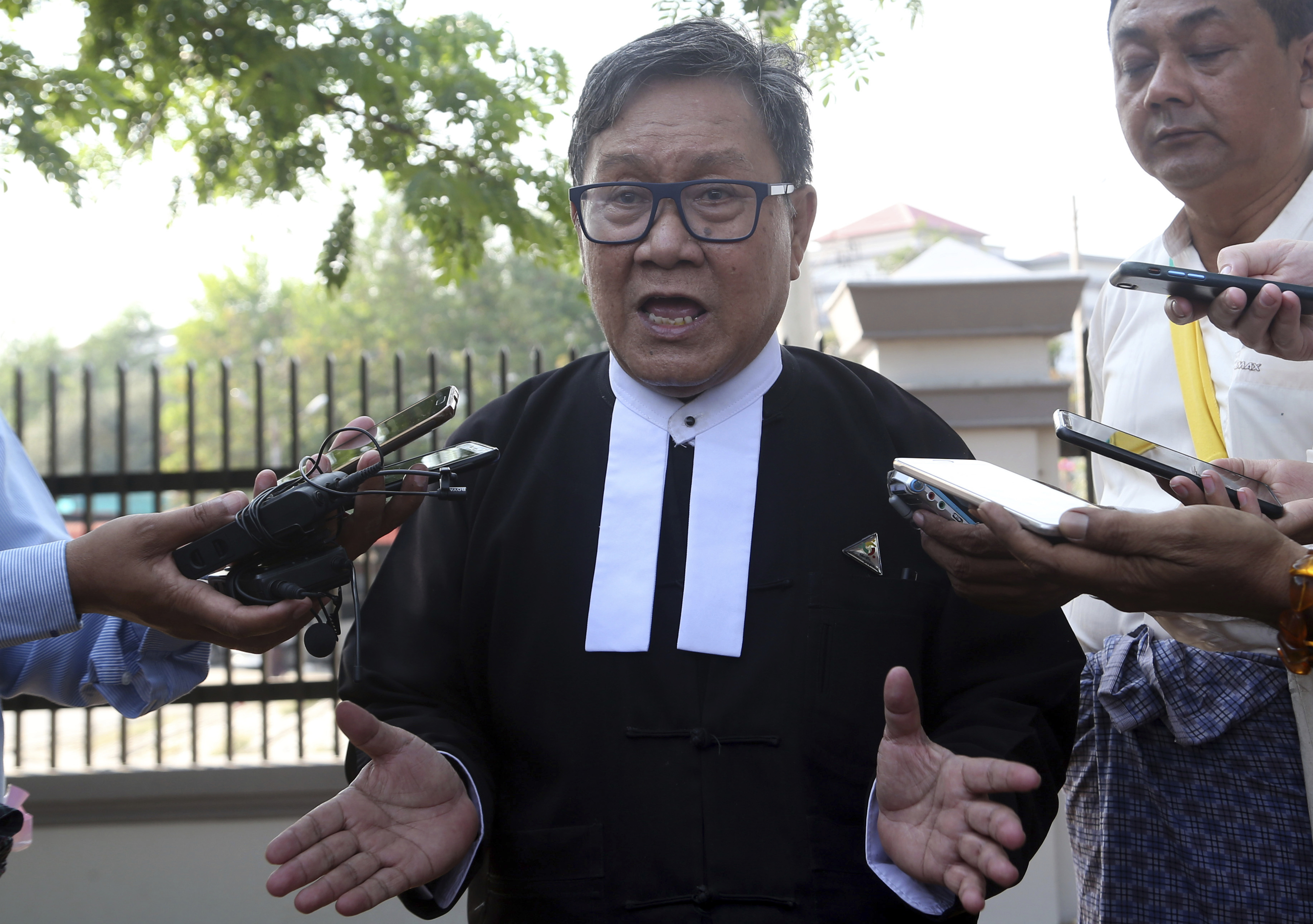 Khin Maung Zaw, a lawyer of two Reuters journalists, Wa Lone and Kyaw Soe Oo, talks to journalists as he leaves the Supreme Court in Naypyitaw, Myanmar, March 26, 2019.