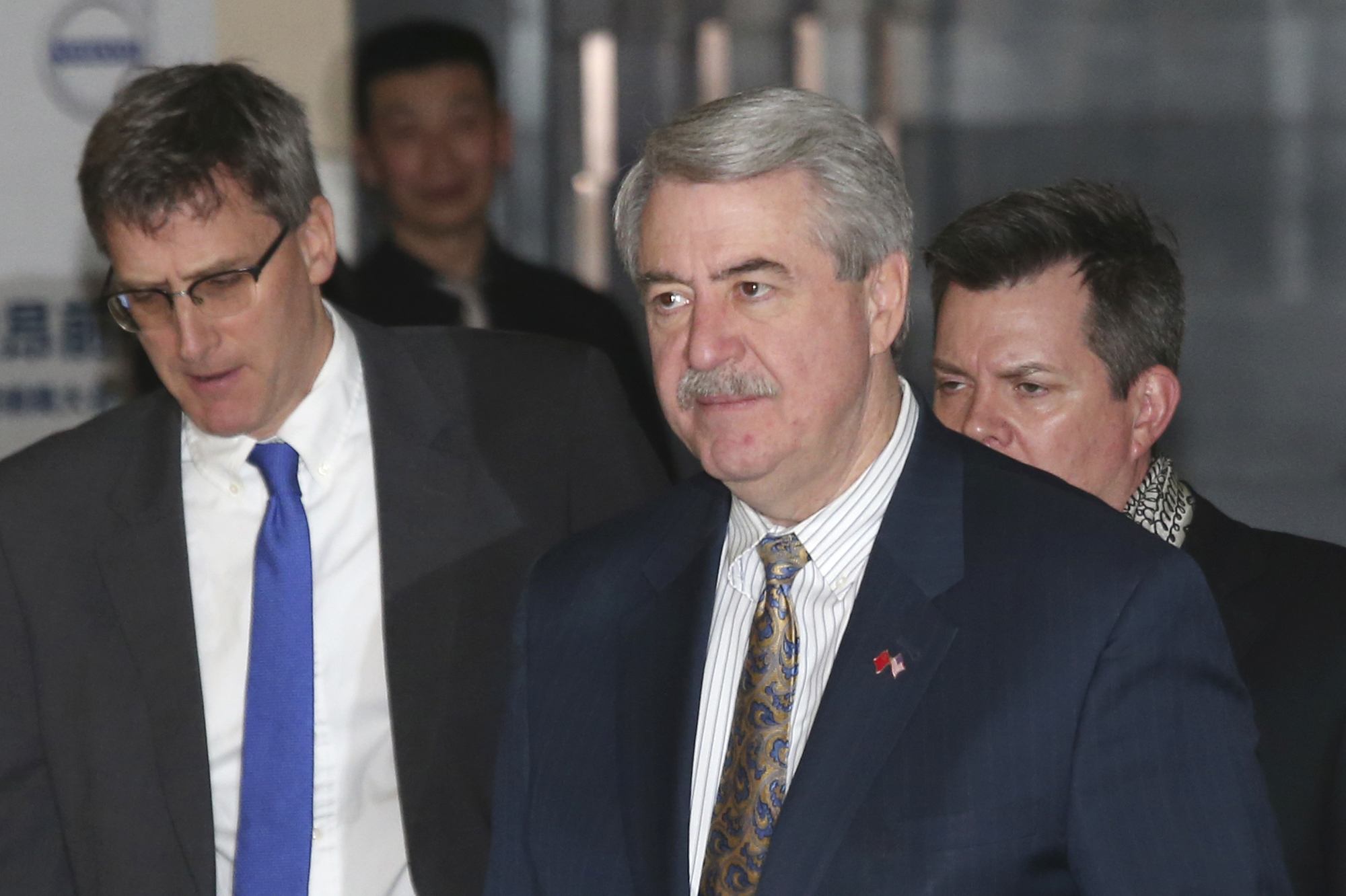 U.S. Undersecretary for Trade and Foreign Agricultural Affairs Ted McKinney, center, who is part of U.S. trade delegation leaves from a hotel for a second day of meetings with Chinese officials in Beijing, China, Jan. 8, 2019.