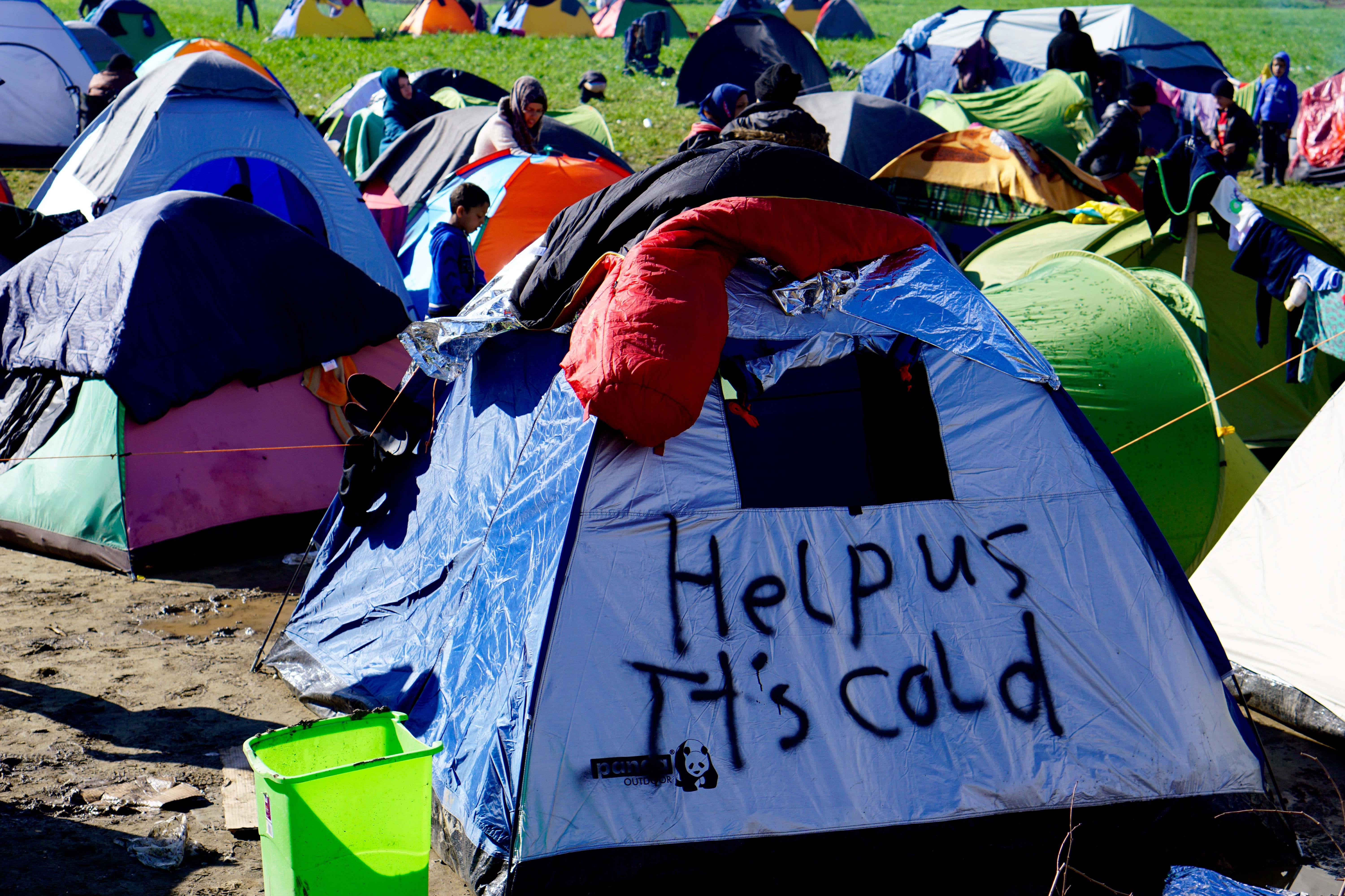 A tent bears an appeal for aid to migrants encamped in Idomeni, Greece, near the border with Macedonia, March 4, 2016.