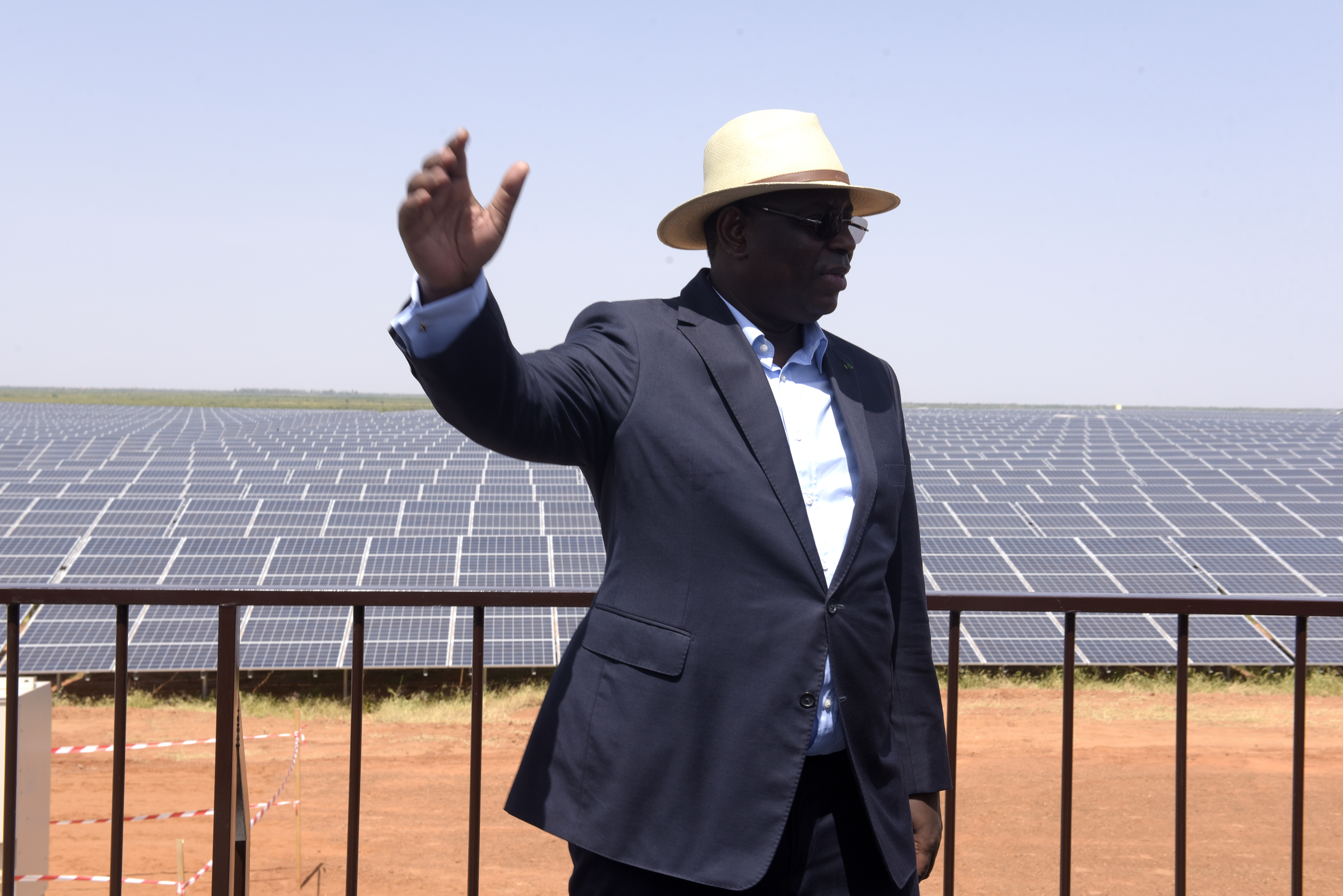 FILE - Senegal President Macky Sall poses in front of solar panels on Oct.  22, 2016 during the opening ceremony of a new photovoltaic energy production site in Bokhol.