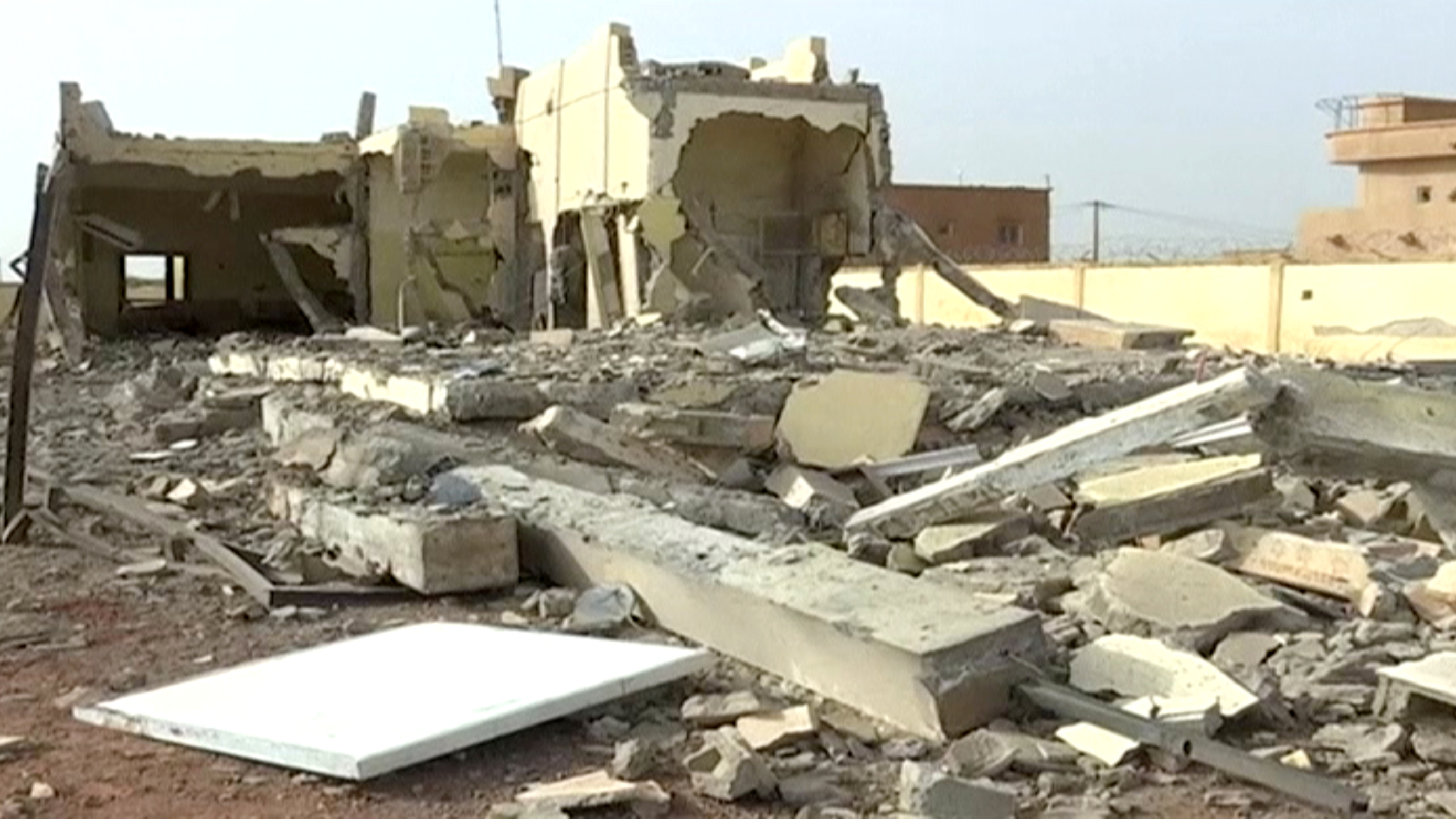 A still image taken from a video shot on June 29, 2018, shows damaged buildings inside the headquarters of the G5 Sahel military task force in Sevare, Mali.