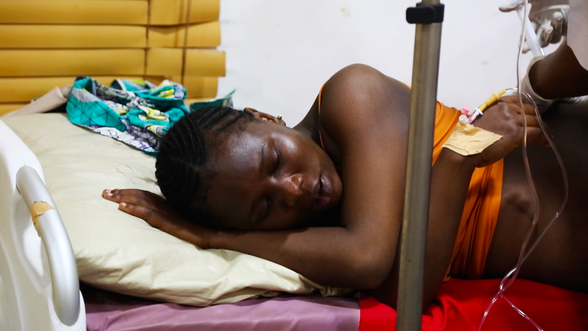 Radiya Rufai is experiencing a lot of pain as her blood pressure rises. It's her first delivery. But cultural norms expect that she suppresses any outward signs of discomfort. (Photo: Chika Oduah for VOA)