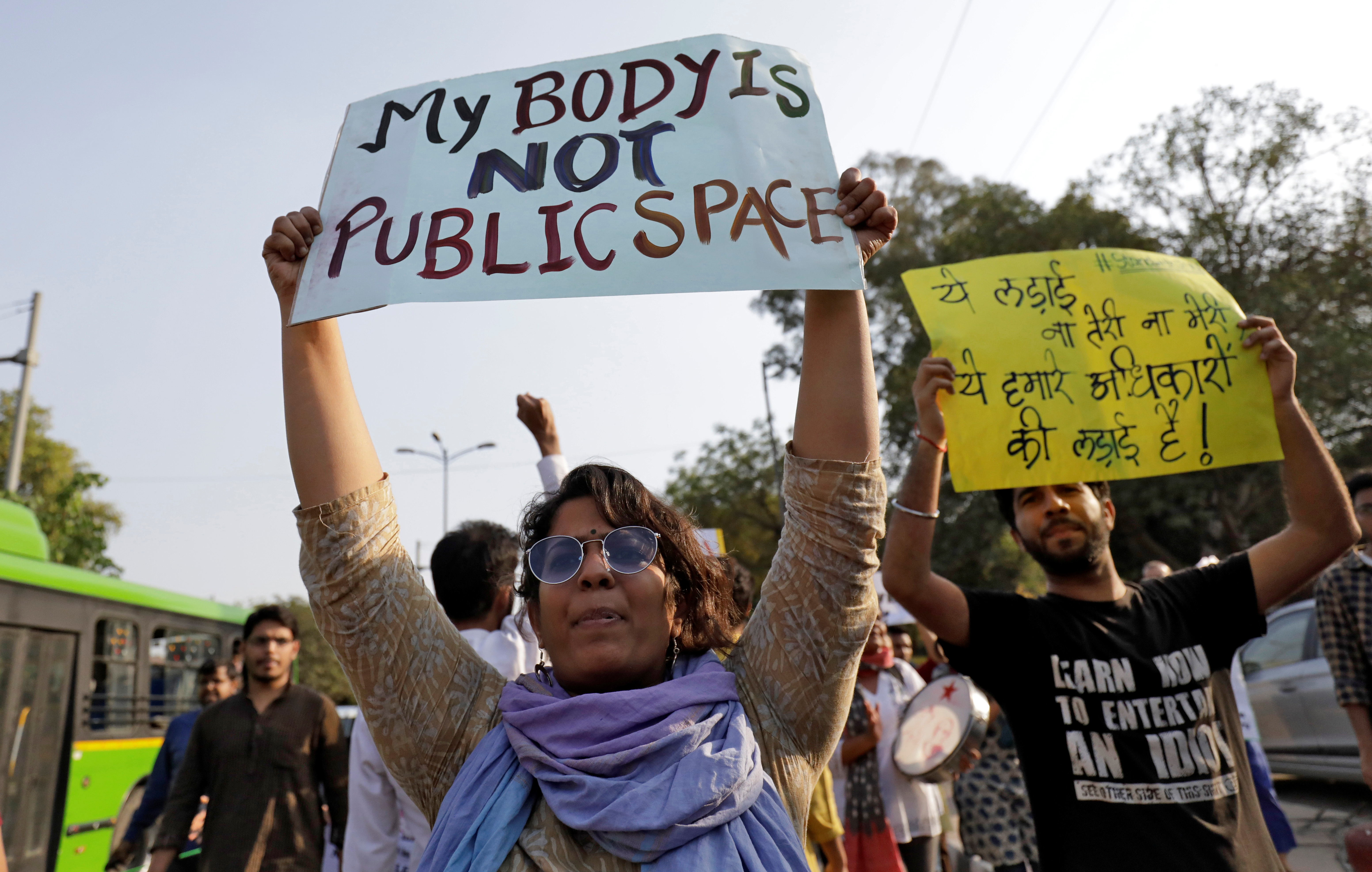 FILE -  Students and teachers of Jawaharlal Nehru University participate in a protest demanding suspension of a professor accused of sexual harassment, in New Delhi, March 23, 2018.