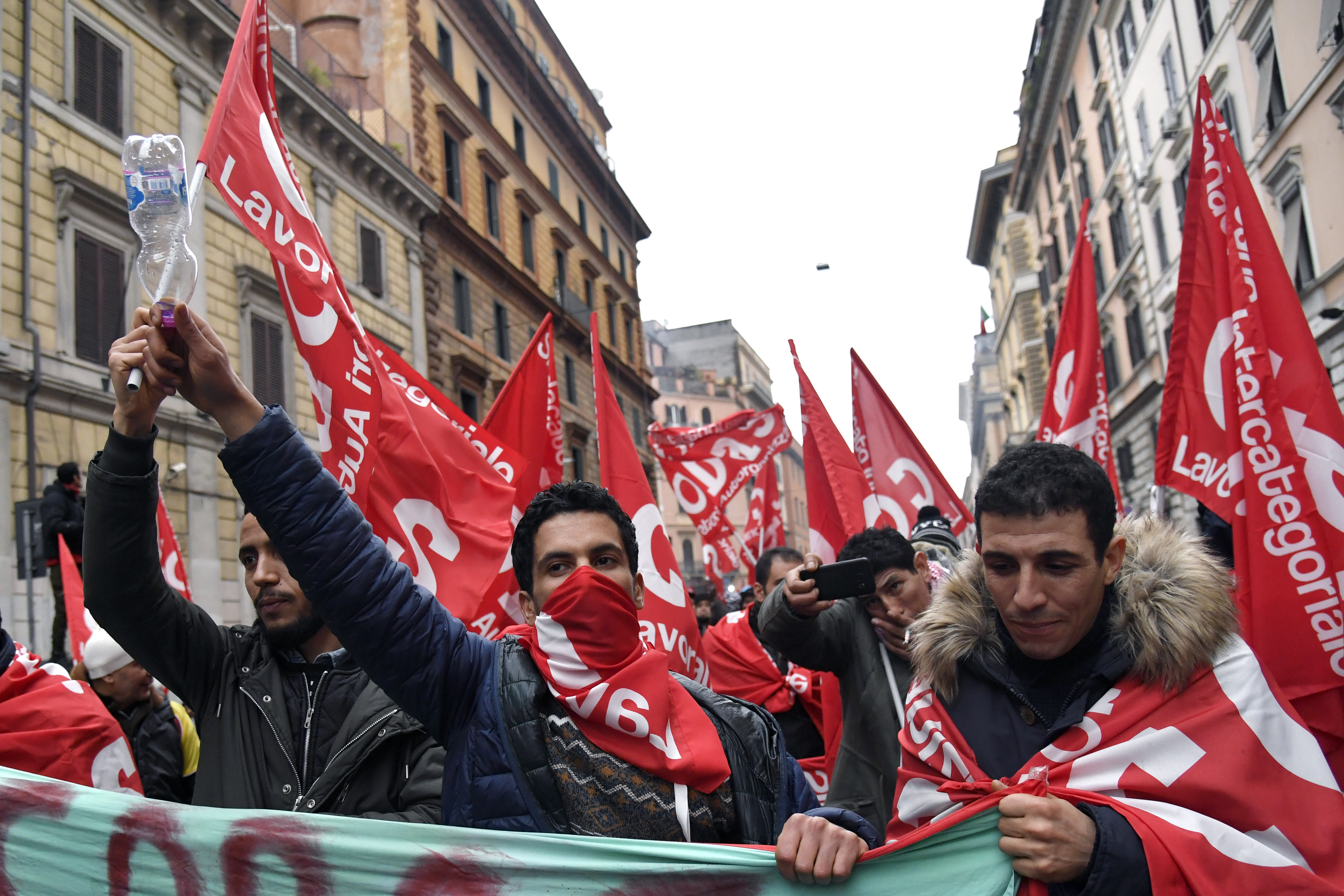 People take part in an anti-fascist march called by Italian left-wing parties and union organizations, in central Rome, Italy, Feb. 24, 2018.