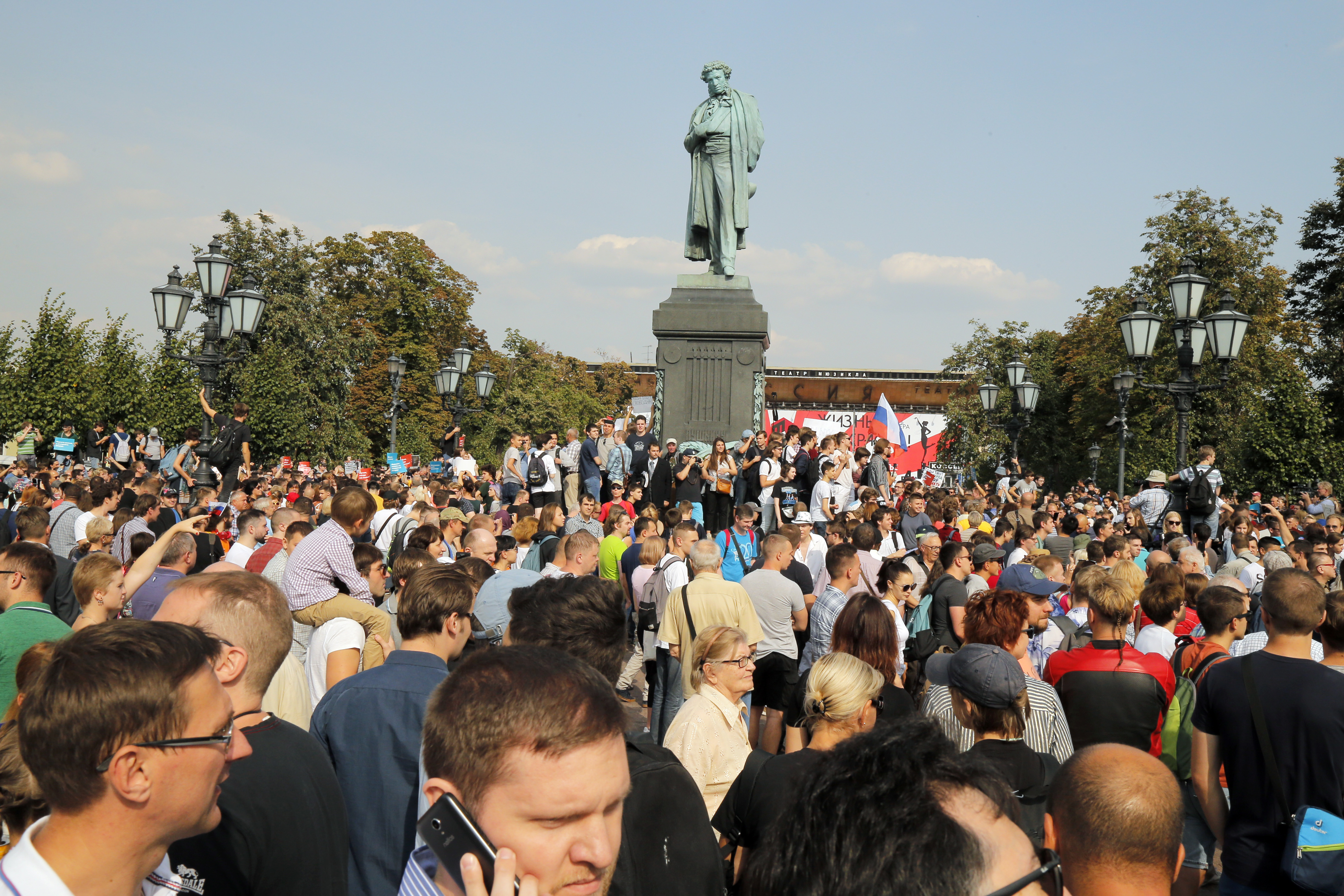 FILE - Protesters attend a rally in Moscow, Russia, Sunday, Sept. 9, 2018.