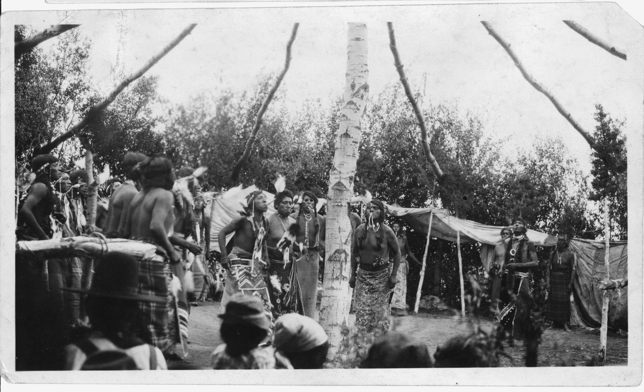 Sun Dance, Shoshone tribe at Fort Hall, 1925.  The dance, criminalized in 1880s, sometimes involved being pierced and suspended by pieces of bone, an act of self-sacrifice for the greater good of the community.