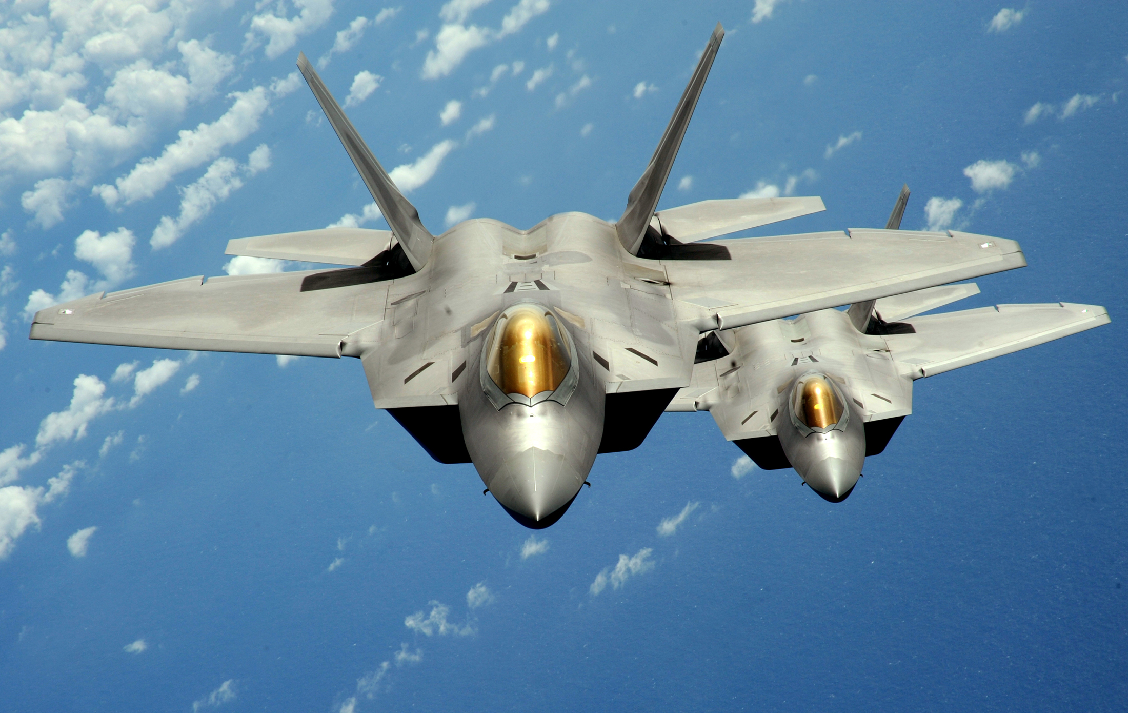 Two U.S. Air Force F-22 Raptor stealth jet fighters fly near Andersen Air Force Base in this handout photo dated Aug. 4, 2010.