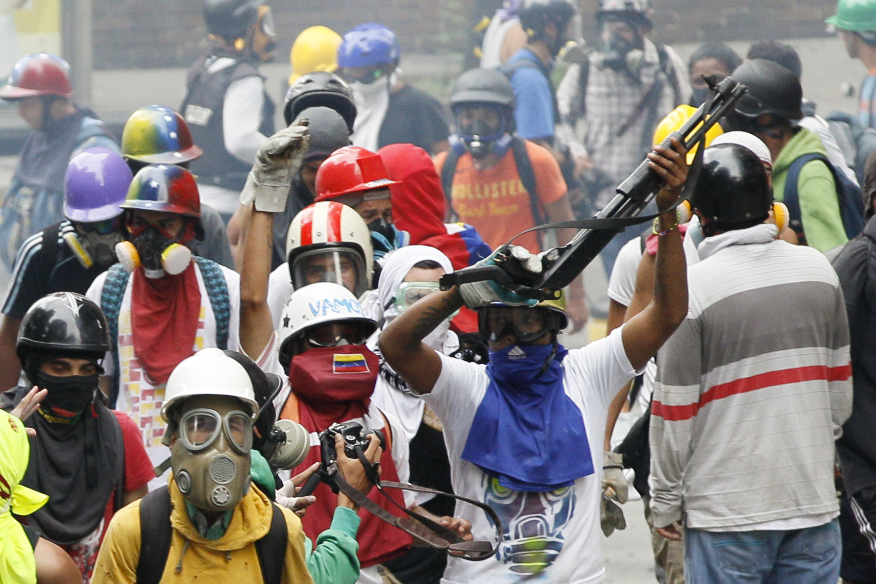 An anti-government demonstrator shows a shotgun taken from security forces during clashes in Caracas, Venezuela, May 8, 2017.