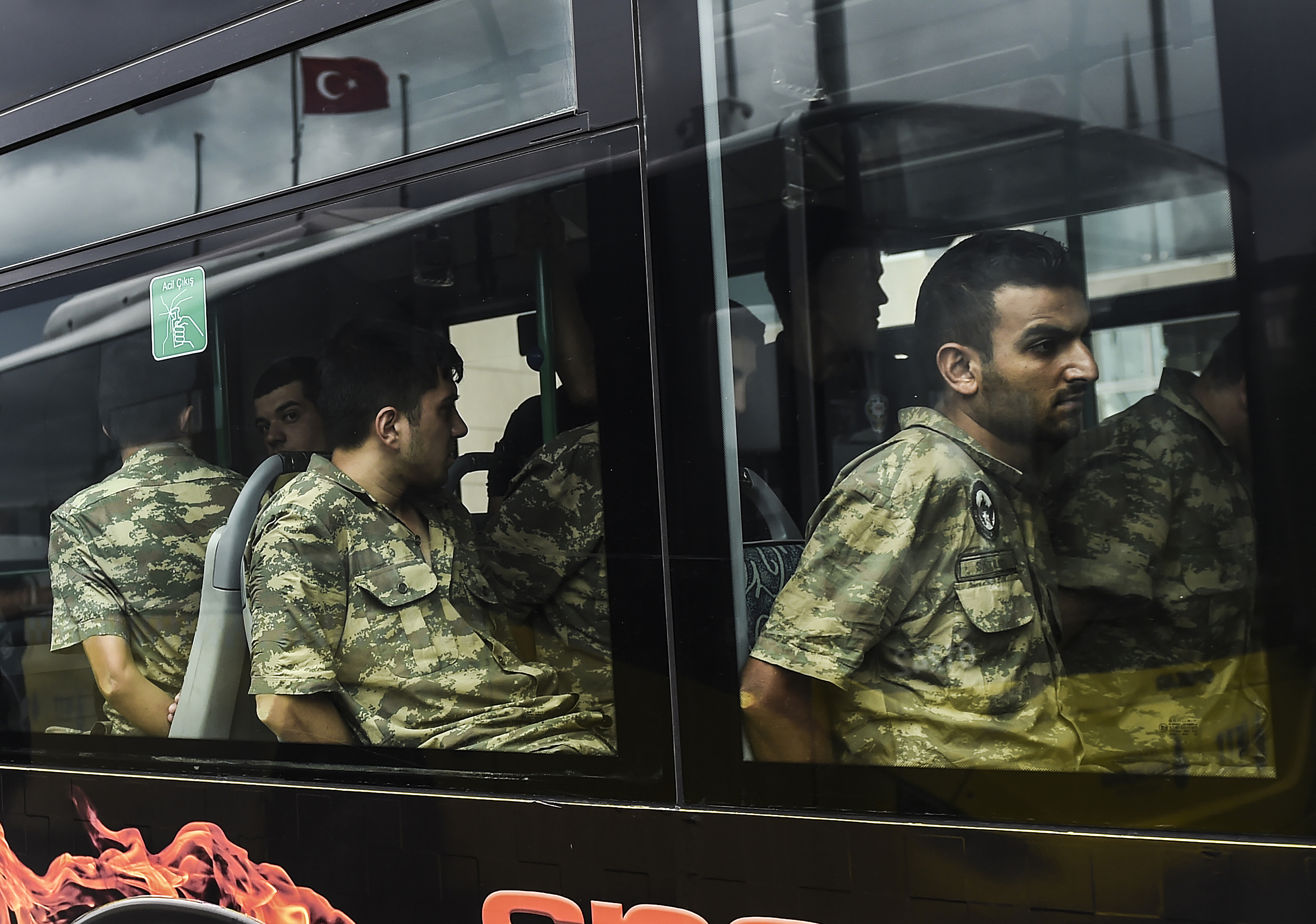 Detained Turkish soldiers who allegedly took part in a military coup arrive in a bus at the courthouse in Istanbul on July 20, 2016, following the military coup attempt of July 15.