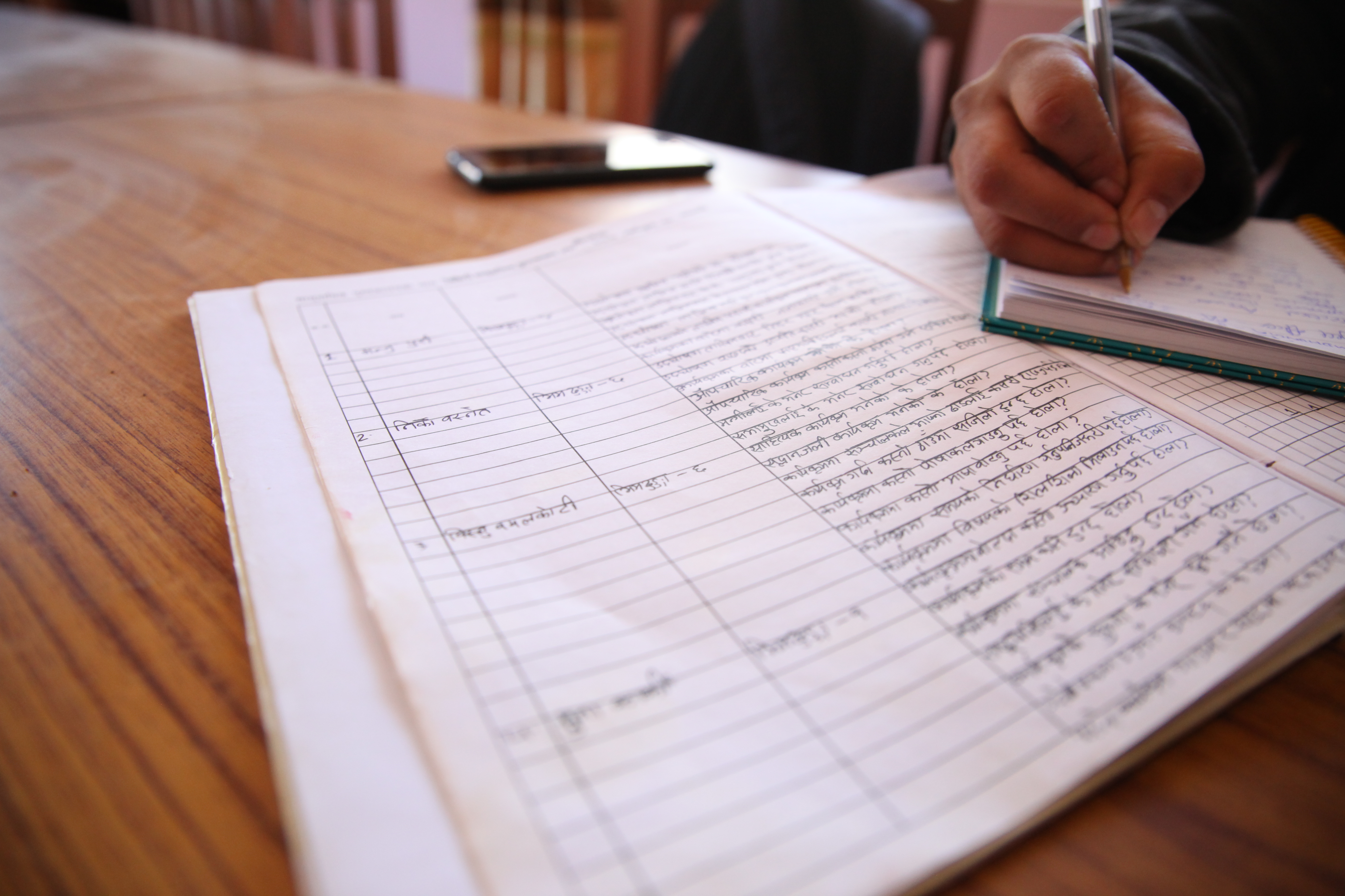 Dense pages filled with Nepali writing include questions from community members to the Tribeni community library in Bhimdhunga, Nepal, Feb. 9, 2018.