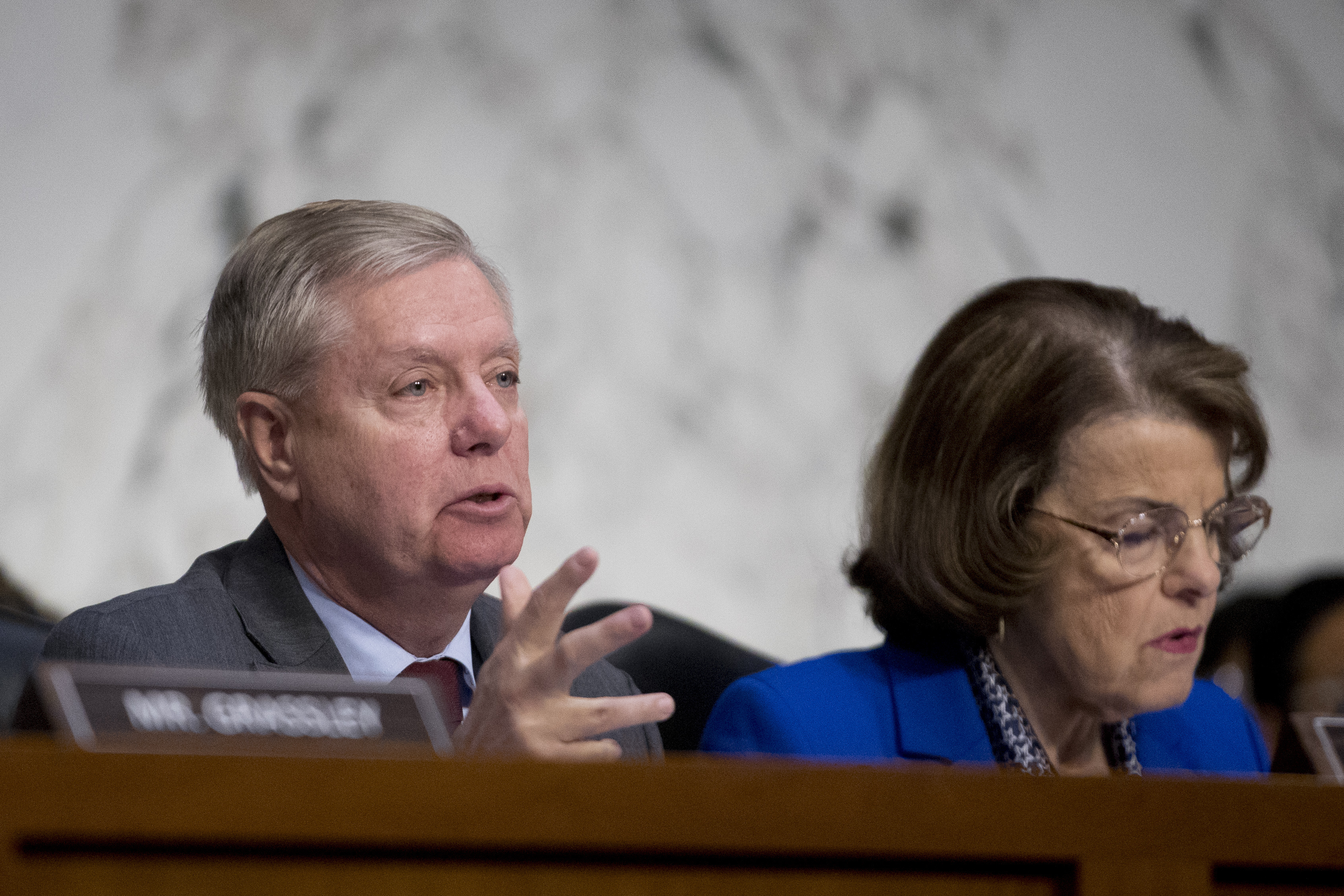 Senate Judiciary Committee Chairman Lindsey Graham, R-S.C., accompanied by Ranking Member Sen. Dianne Feinstein, D-Calif.,(R) questions Attorney General nominee William Barr during a Senate Judiciary Committee hearing on Capitol Hill in Washington, J...