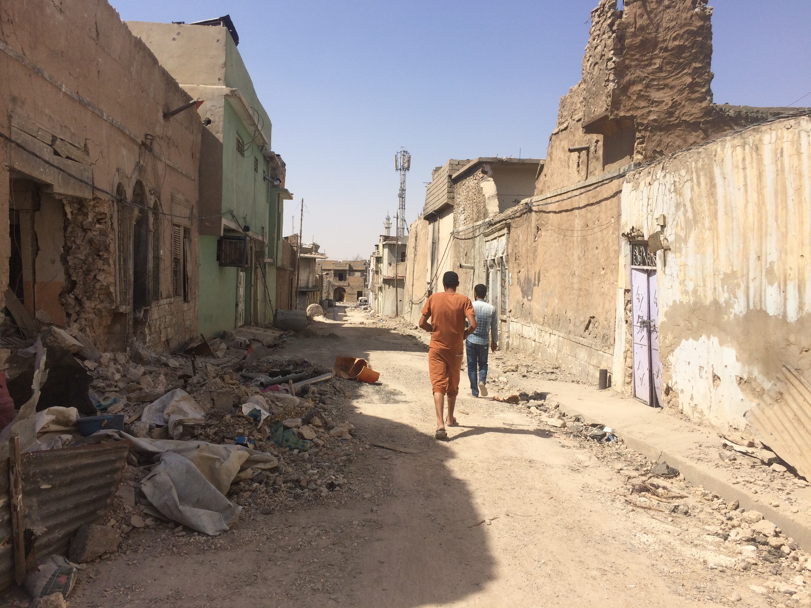 Families visit their homes in Mosul's Old City but say its too dangerous to move back home as authorities continue to clear bombs and bodies out of the neighborhood on Sept. 29, 2017.