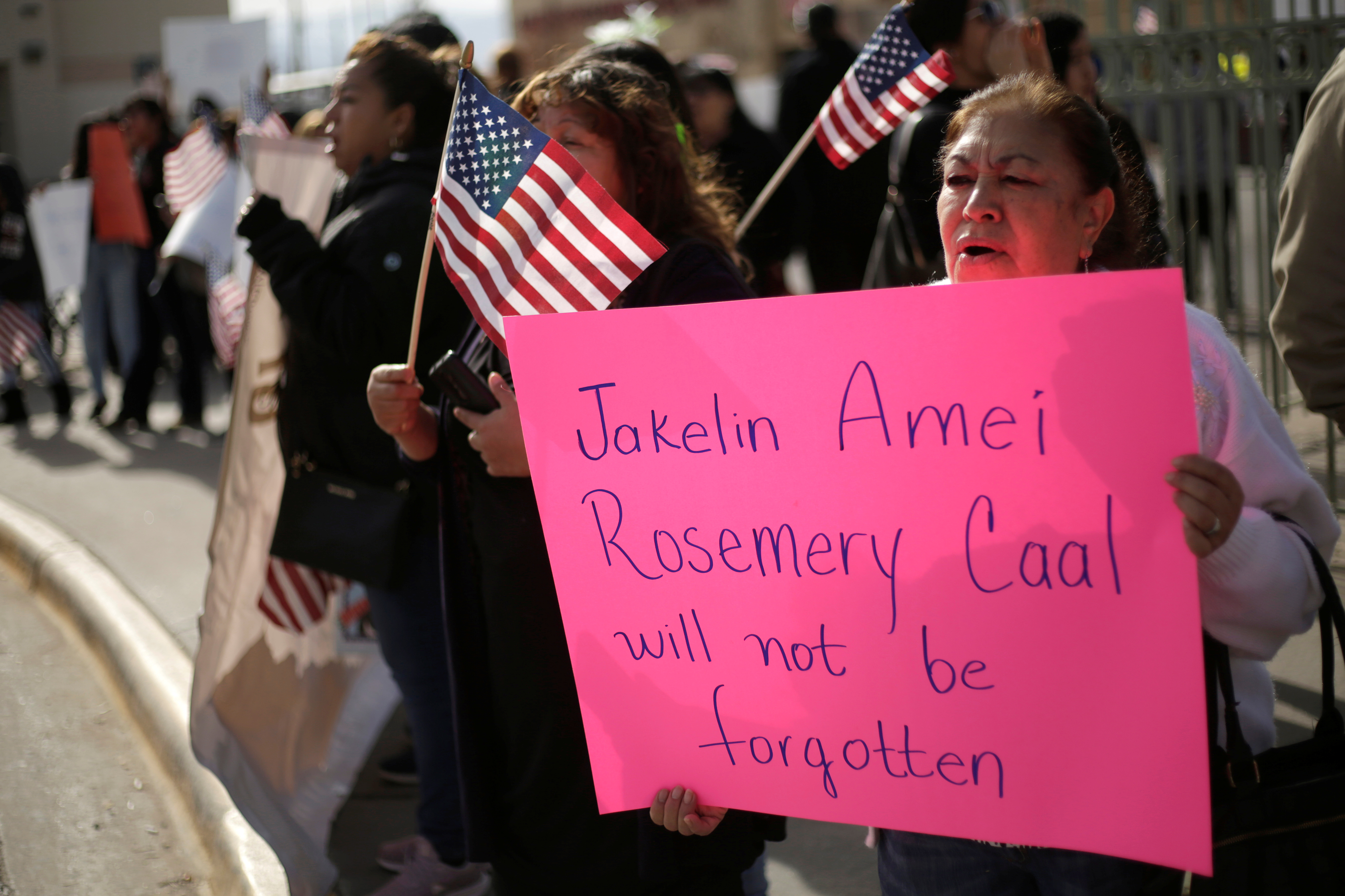 A woman holds a placard for Jakelin Caal Maquin, a 7-year-old Guatemalan girl who died in U.S. custody after crossing illegally from Mexico to the U.S., during a protest held to demand justice for her in El Paso, Texas, Dec. 15, 2018.